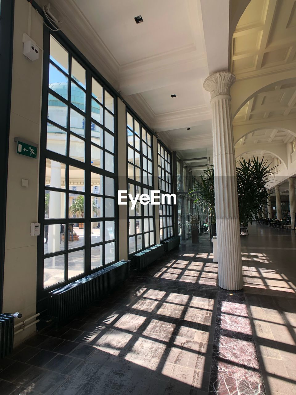 window, architecture, indoors, day, built structure, sunlight, no people, flooring, building, shadow, glass - material, ceiling, nature, empty, absence, transparent, architectural column, corridor, arcade, tiled floor