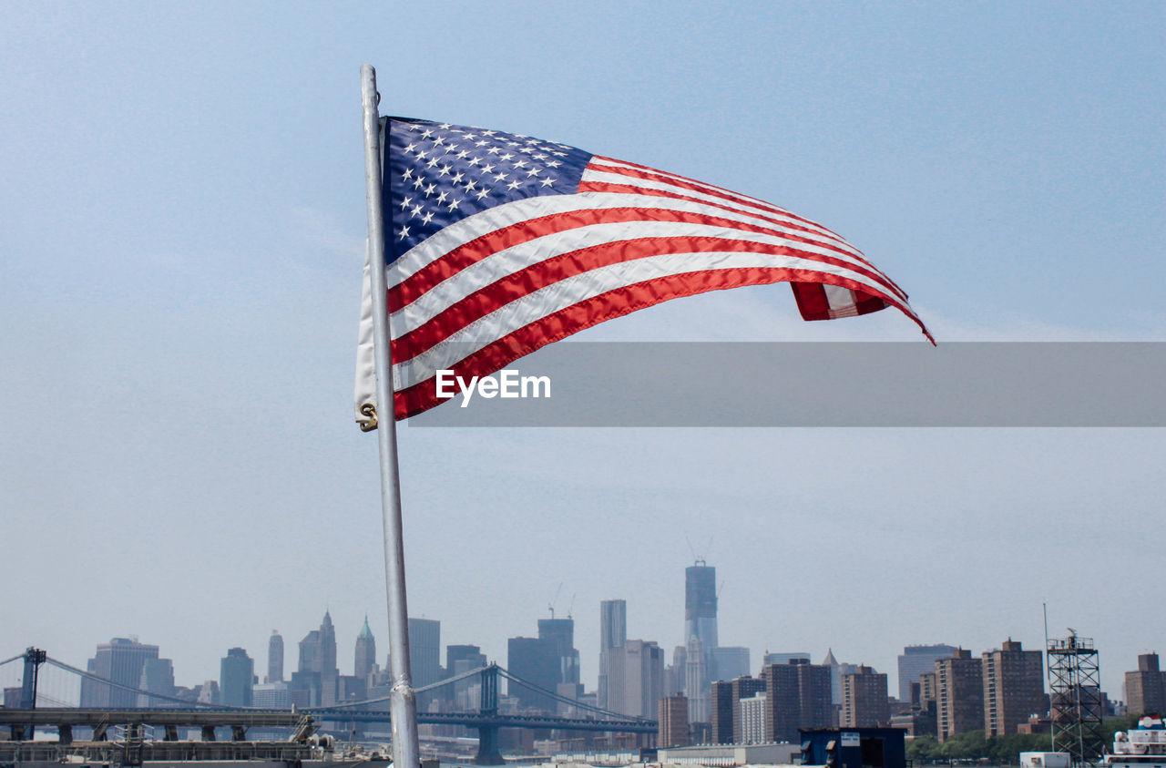 American Flag Against Buildings