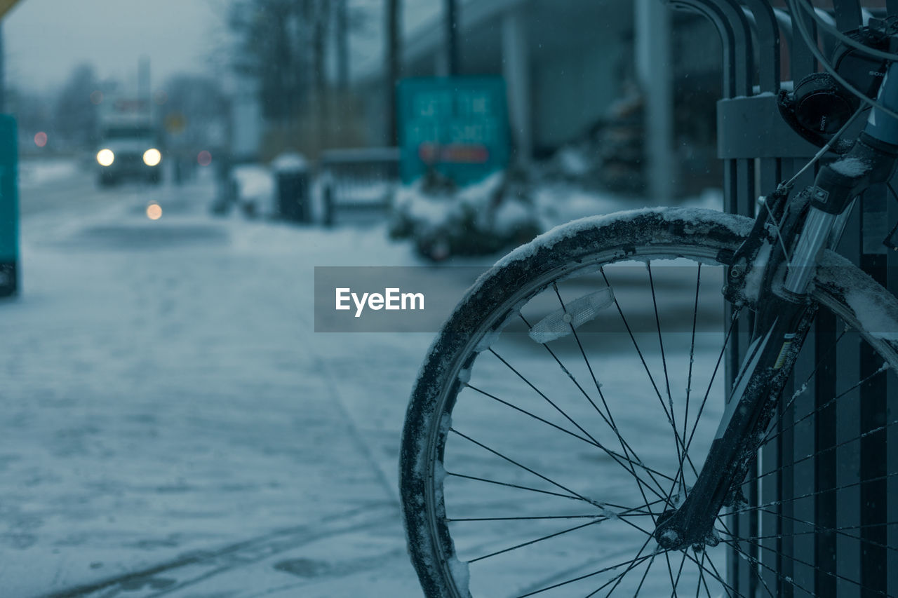 Close-Up Of Bicycle Wheel On Sidewalk During Winter