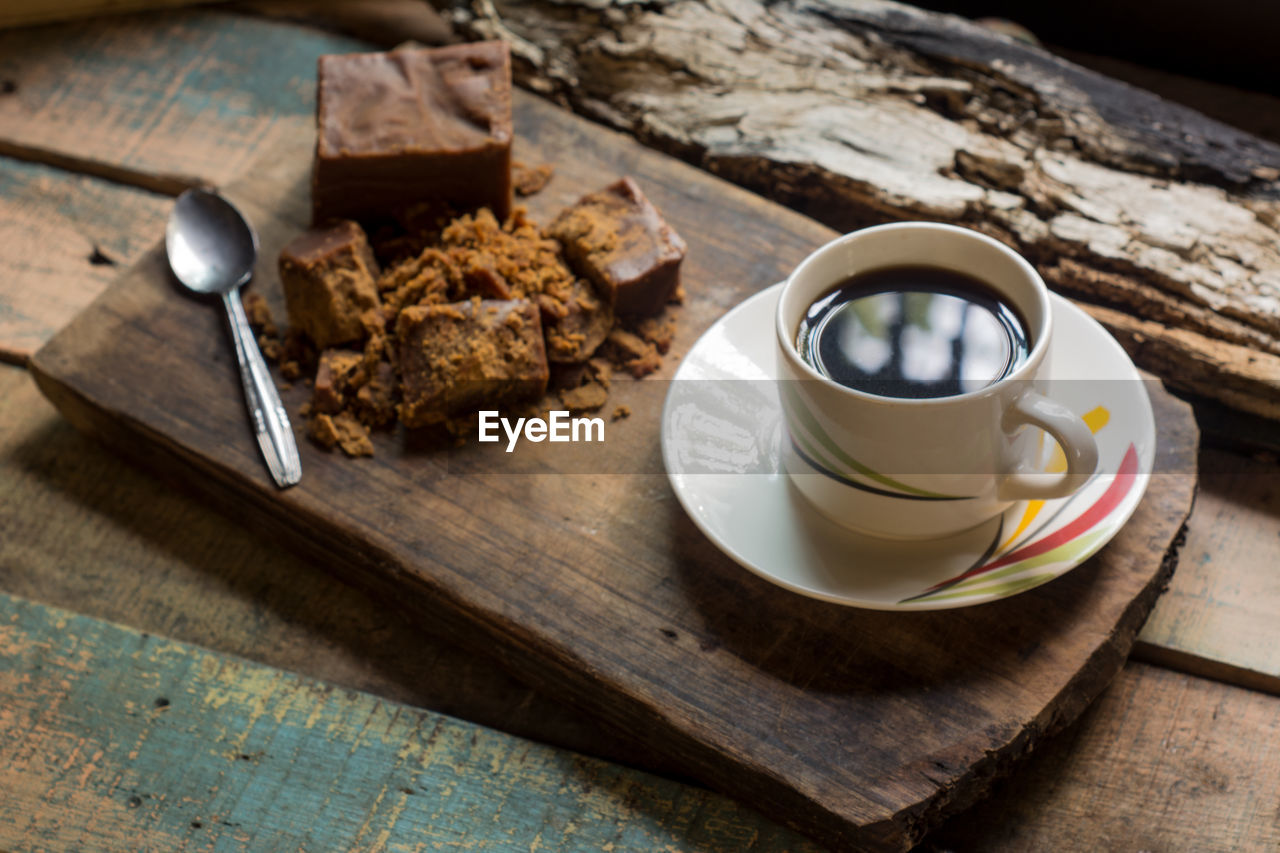 High Angle View Of Black Coffee With Dessert On Table