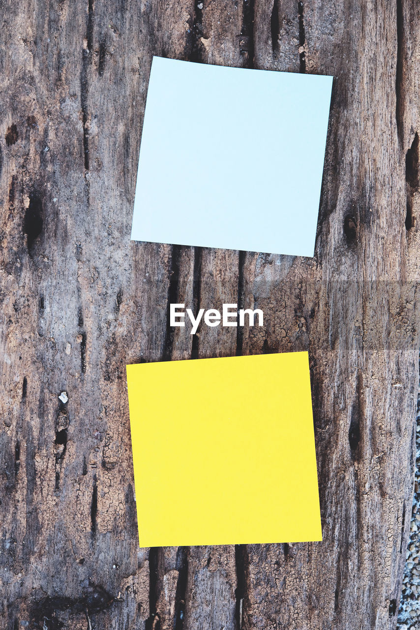 Close-Up Of Adhesive Notes On Wood