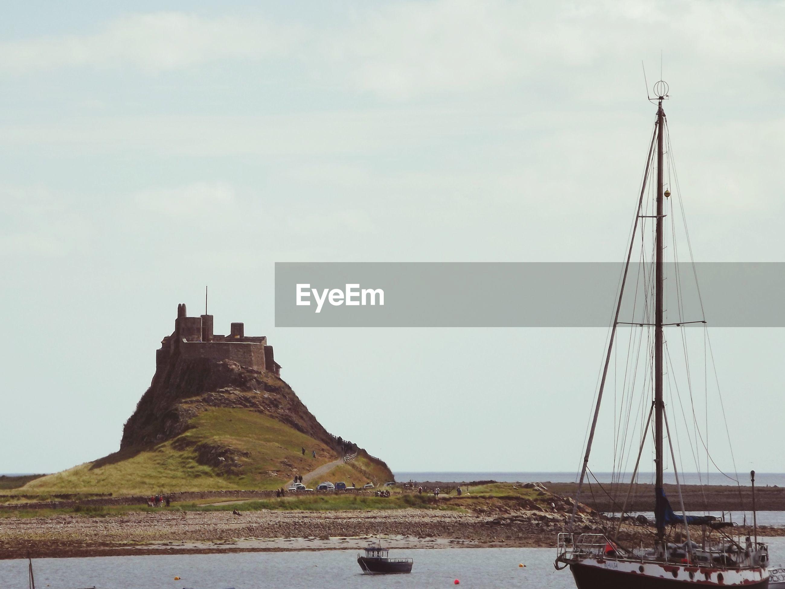 Sailboat in sea against sky at wooler