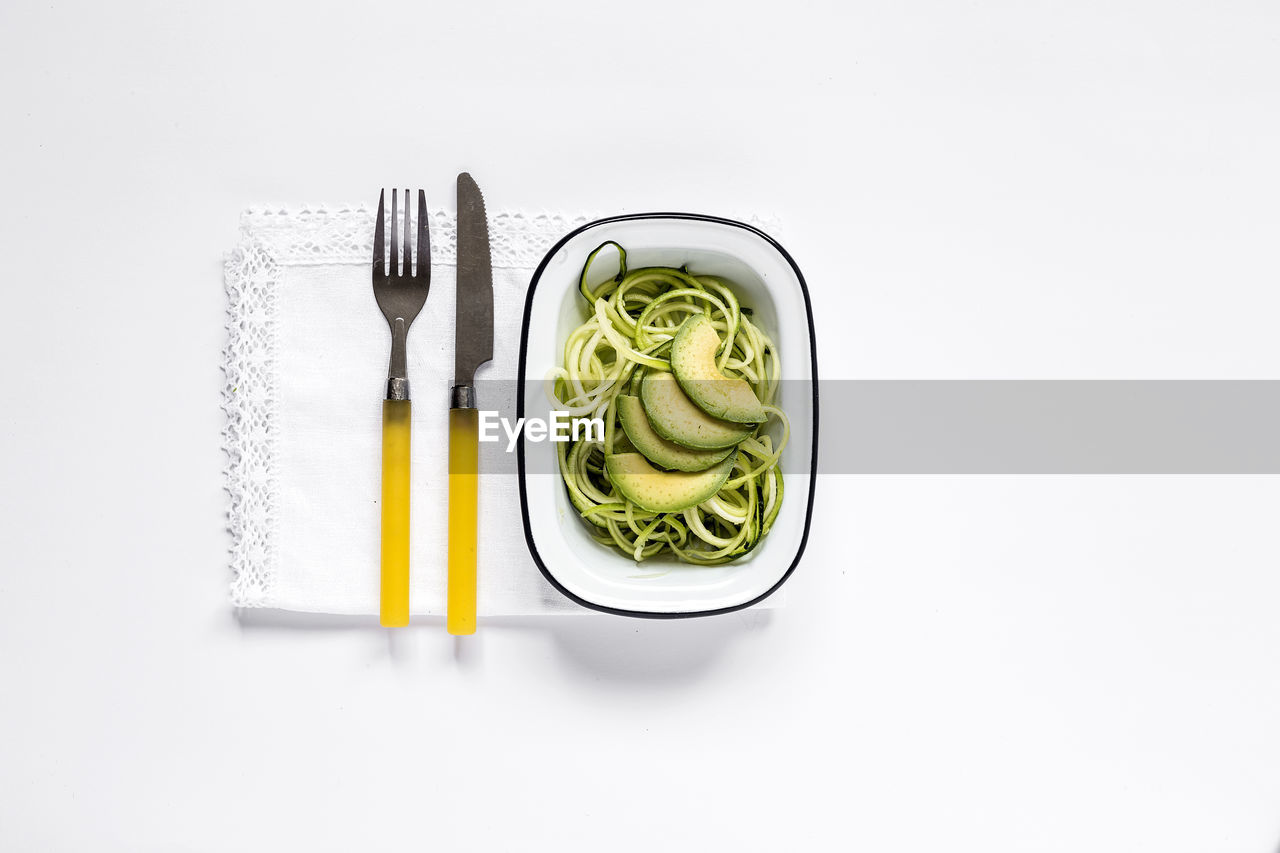 fork, eating utensil, still life, white background, studio shot, kitchen utensil, indoors, food and drink, freshness, food, green color, directly above, no people, high angle view, healthy eating, copy space, vegetable, household equipment, wellbeing, knife, table knife