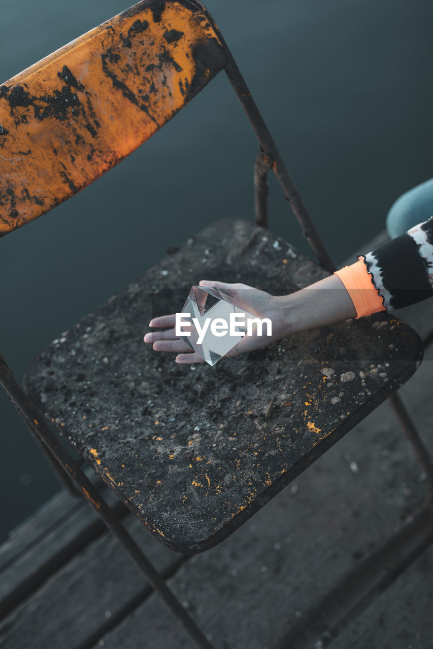 one person, high angle view, real people, hand, holding, human hand, day, cigarette, smoking issues, outdoors, burnt, human body part, nature, social issues, bad habit, communication, burning, cigarette butt