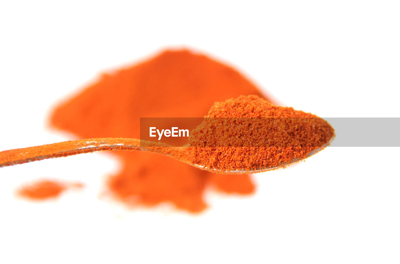 white background, studio shot, close-up, orange color, eating utensil, food, indoors, food and drink, freshness, ingredient, spoon, still life, spice, kitchen utensil, no people, cut out, wellbeing, red, healthy eating, focus on foreground, temptation