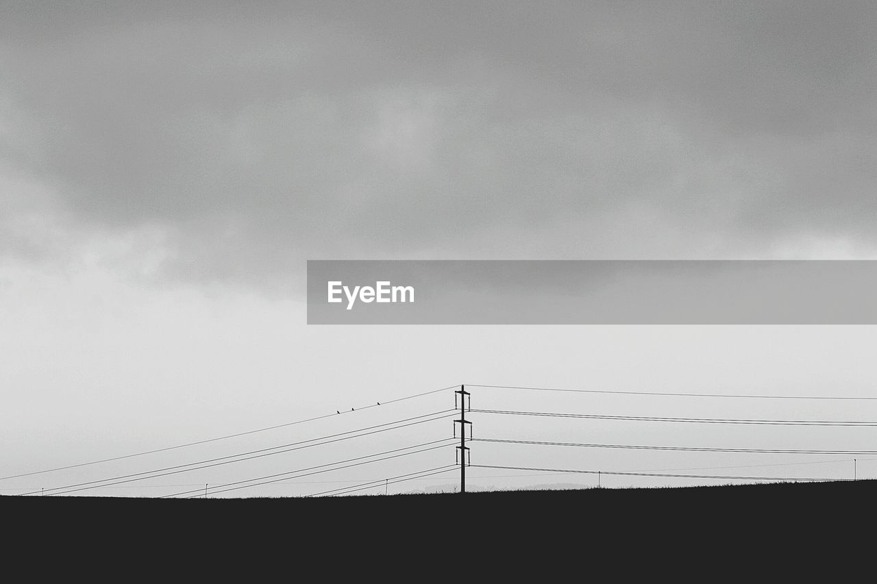sky, cloud - sky, electricity, cable, power line, connection, technology, nature, no people, power supply, low angle view, fuel and power generation, electricity pylon, day, silhouette, outdoors, copy space, overcast, architecture, telephone line, electrical equipment