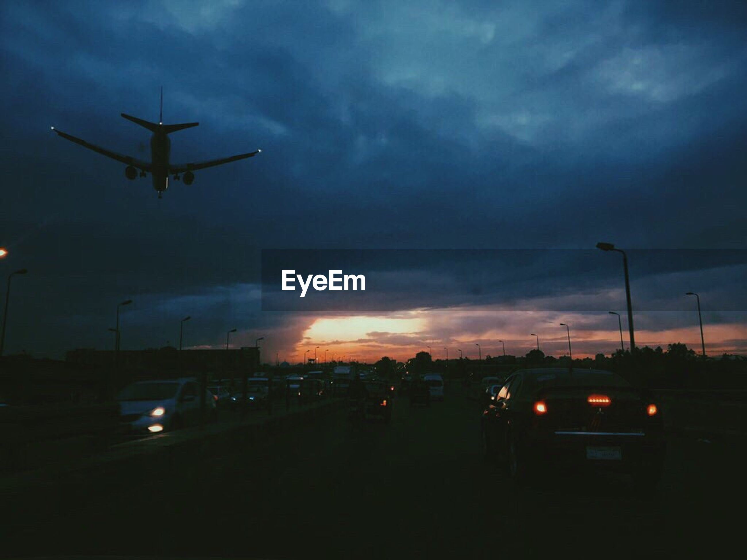 transportation, cloud - sky, sky, travel, mode of transport, journey, dramatic sky, sunset, outdoors, airplane, no people, storm cloud, nature, night, illuminated, air vehicle, airport runway, drone