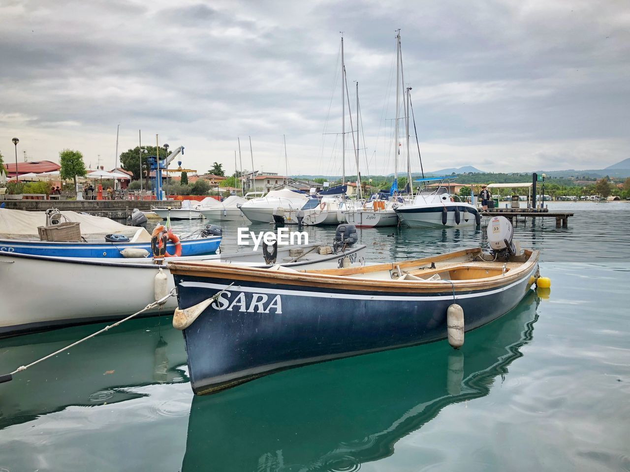 nautical vessel, transportation, mode of transportation, water, moored, cloud - sky, sky, harbor, nature, sailboat, day, waterfront, sea, pole, reflection, no people, mast, outdoors, pier, marina, fishing industry, port, yacht, fishing boat, anchored