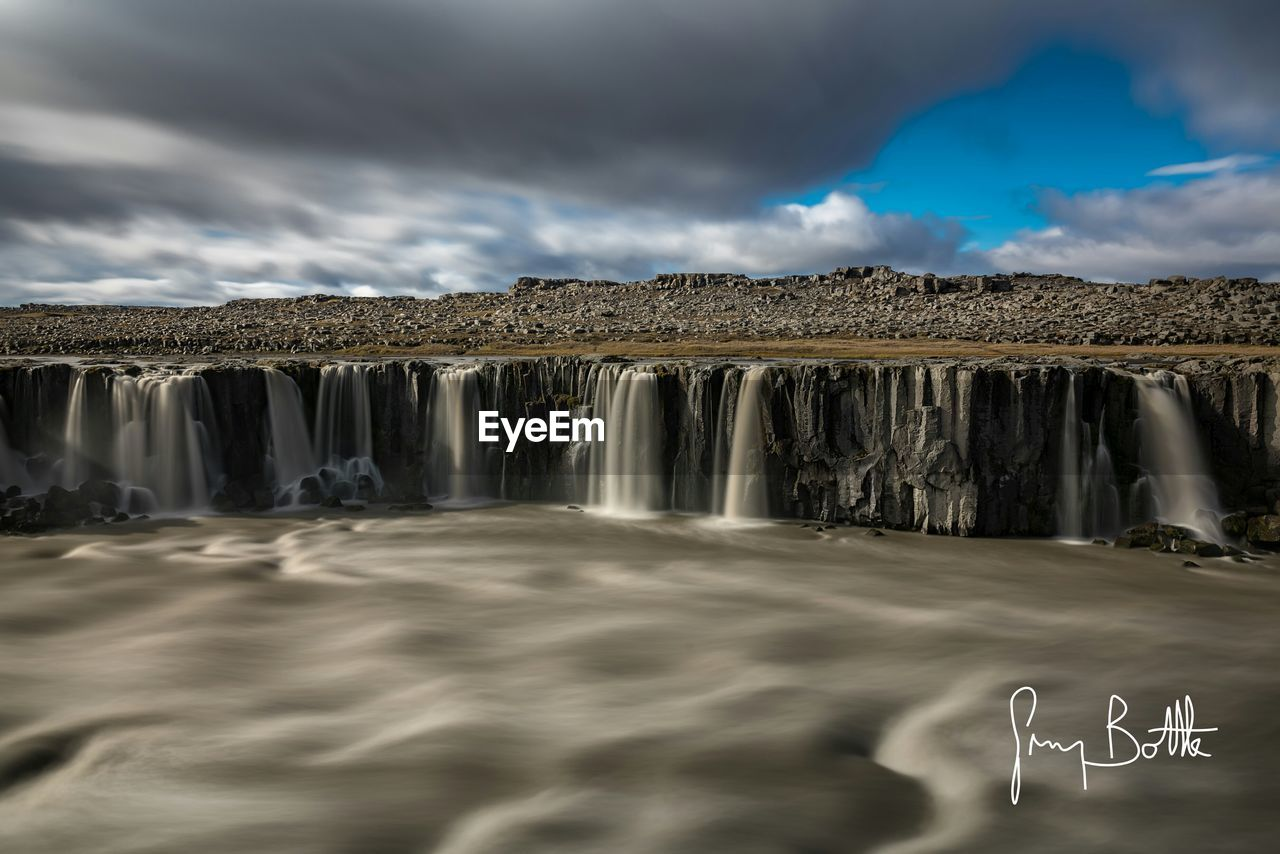 sky, cloud - sky, nature, beauty in nature, scenics, water, day, outdoors, long exposure, no people, motion, waterfall, iceberg