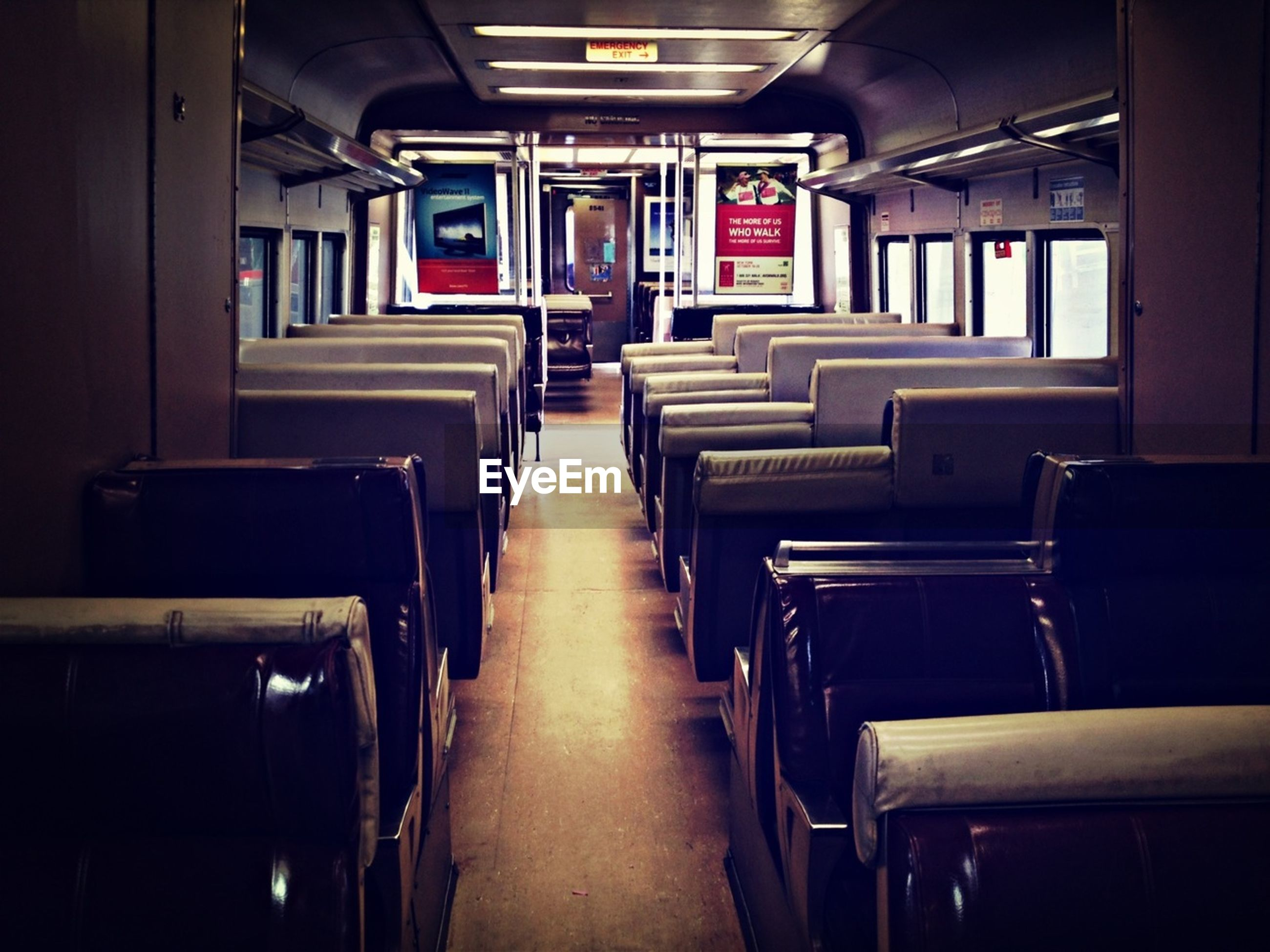 indoors, empty, absence, interior, chair, vehicle seat, seat, in a row, vehicle interior, transportation, illuminated, no people, public transportation, travel, window, diminishing perspective, the way forward, corridor, mode of transport, built structure
