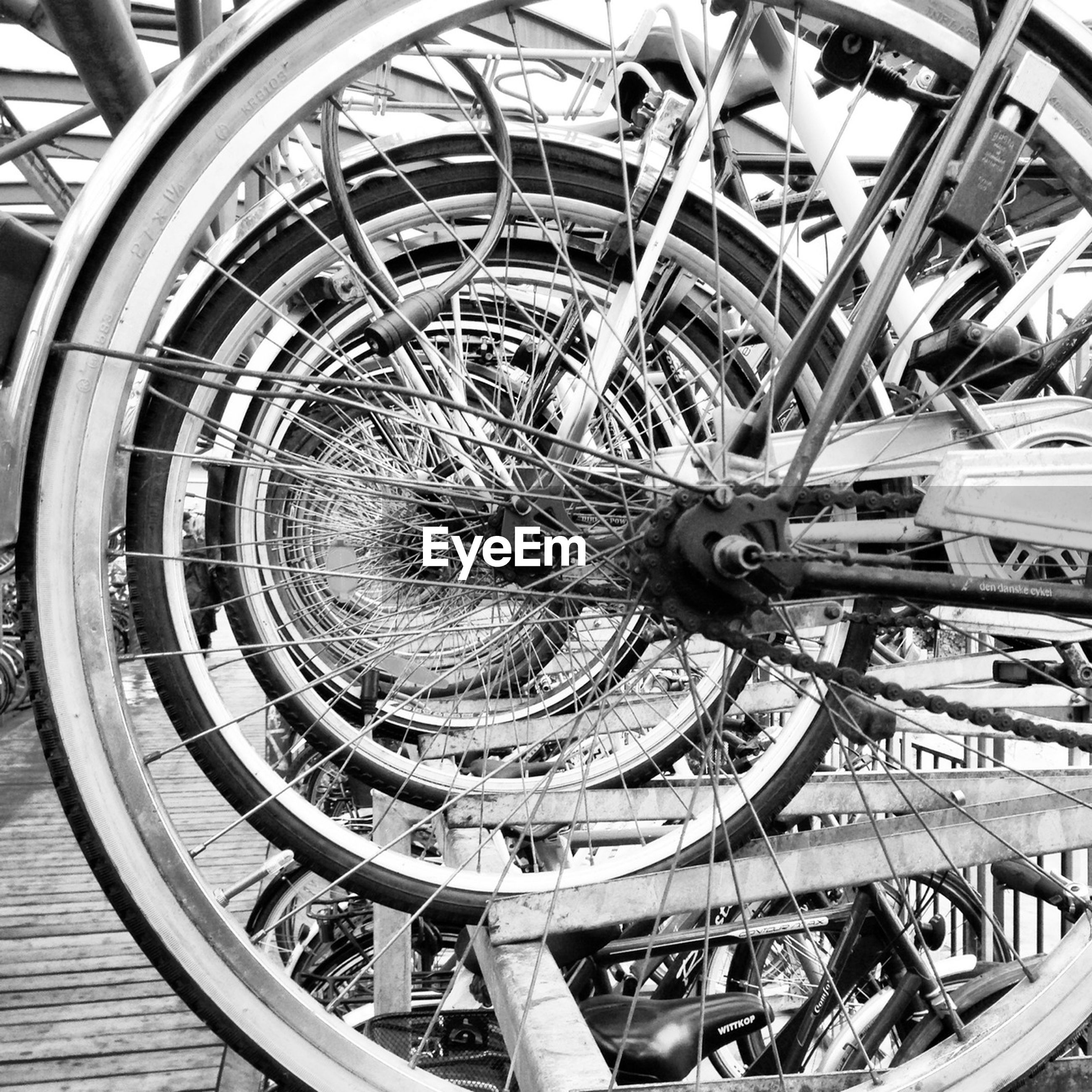 wheel, metal, high angle view, indoors, transportation, spiral, tire, mode of transport, metallic, old, spiral staircase, built structure, steps, wood - material, abandoned, no people, circle, railing, day, architecture