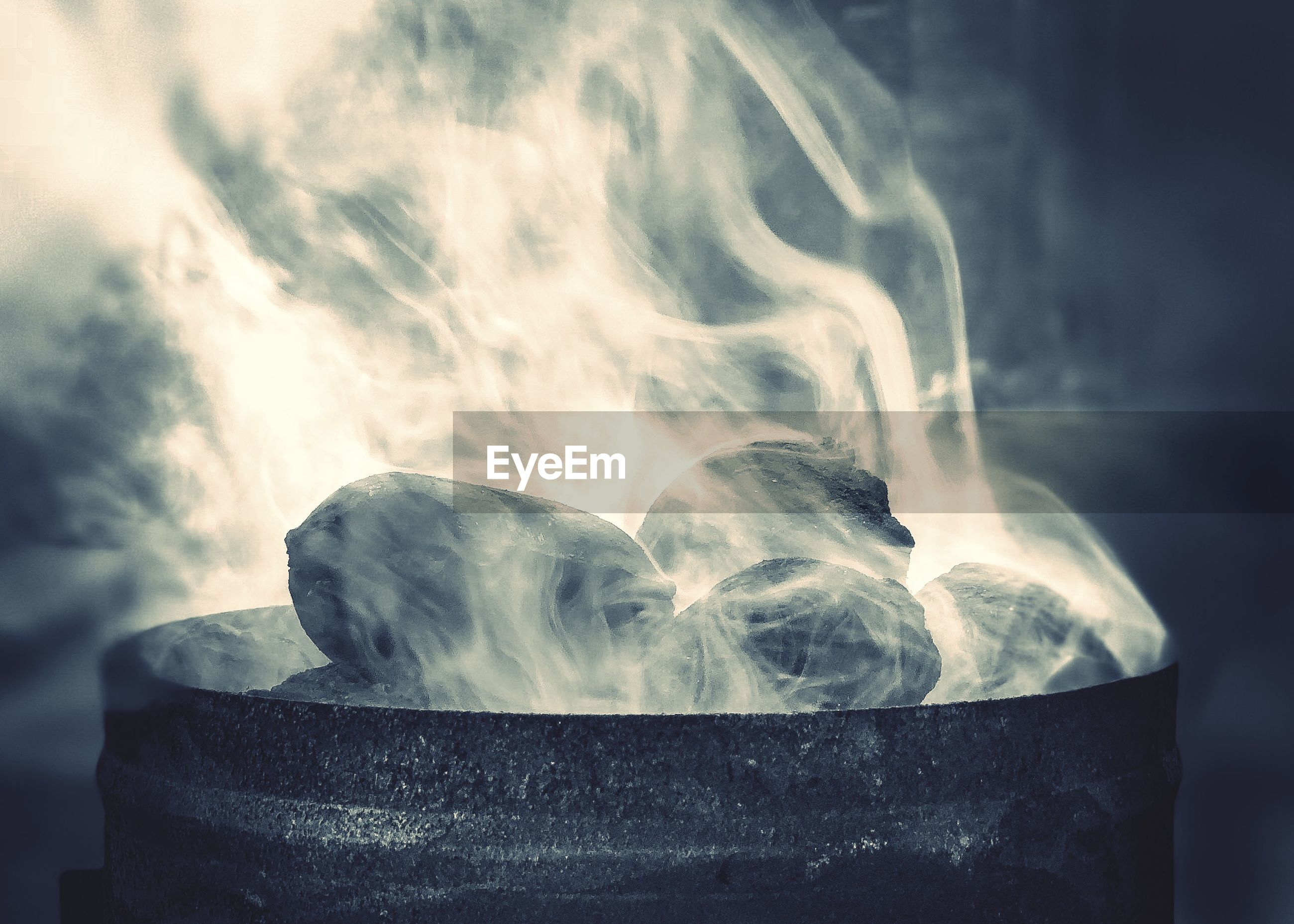 Close-up of smoke emitting from coal