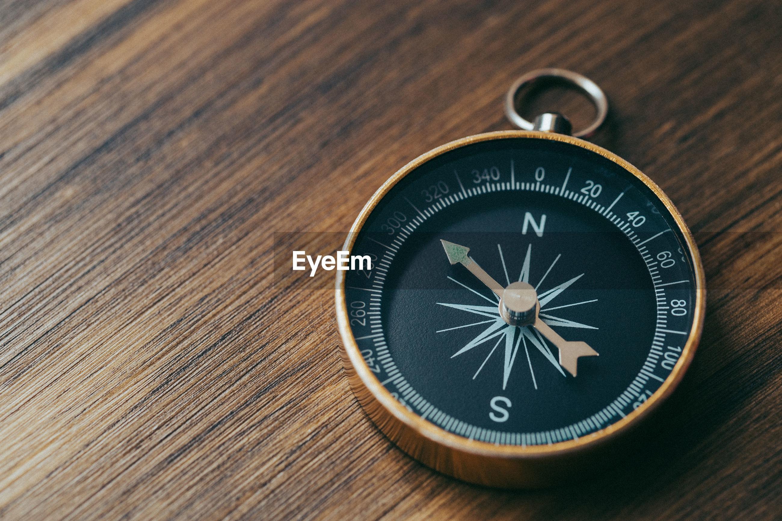 Navigational compass on table