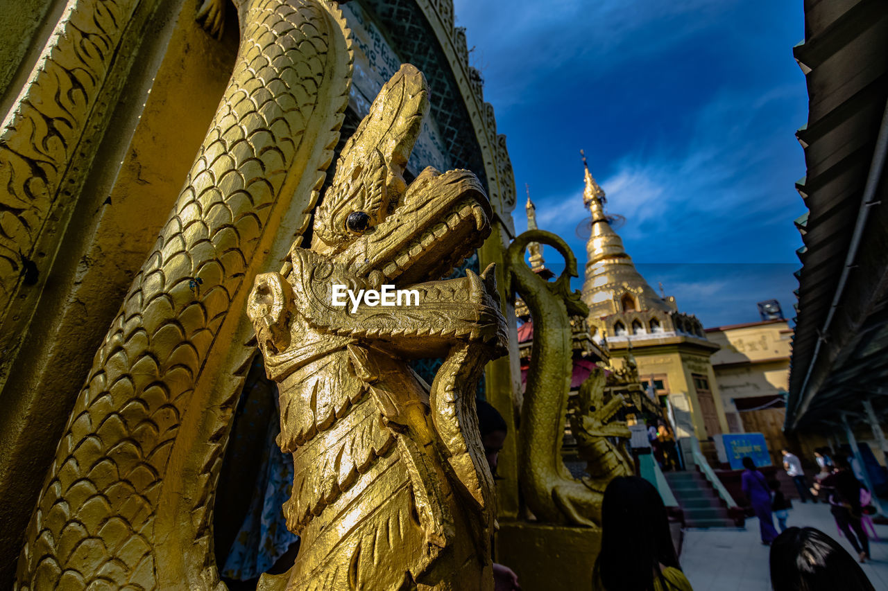PANORAMIC VIEW OF BUDDHA STATUE AGAINST BUILDINGS
