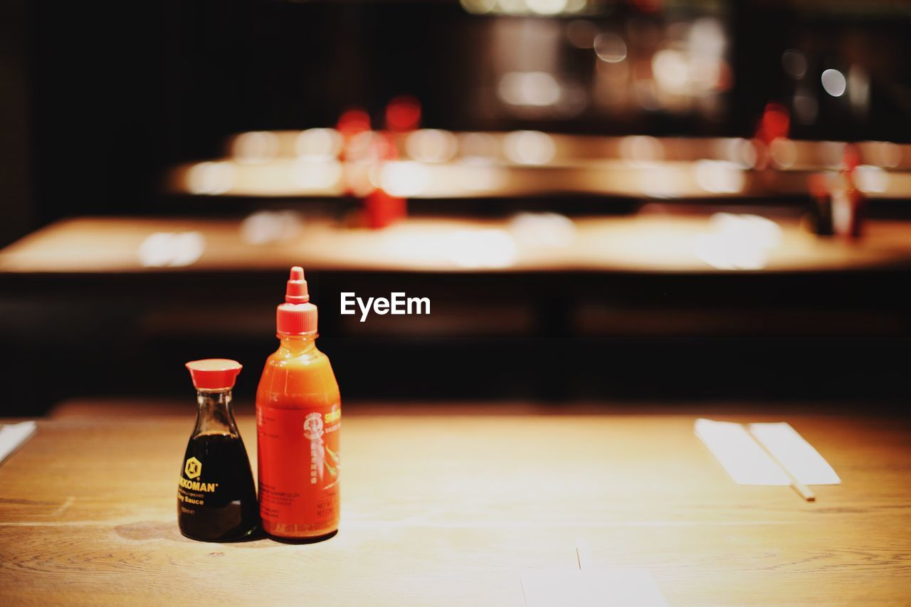 bottle, table, indoors, focus on foreground, food and drink, close-up, no people, freshness, night, food