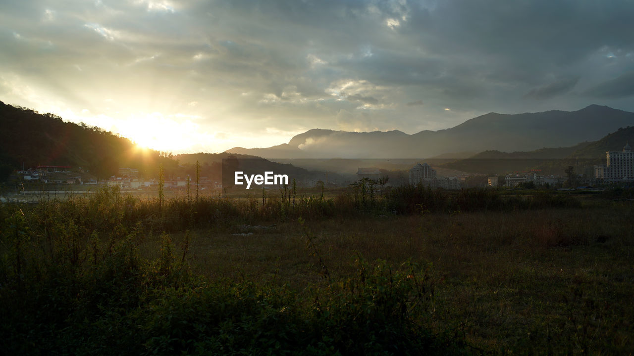 mountain, nature, sunset, no people, sky, scenics, grass, landscape, beauty in nature, tranquility, tranquil scene, outdoors, architecture, day, tree, cityscape