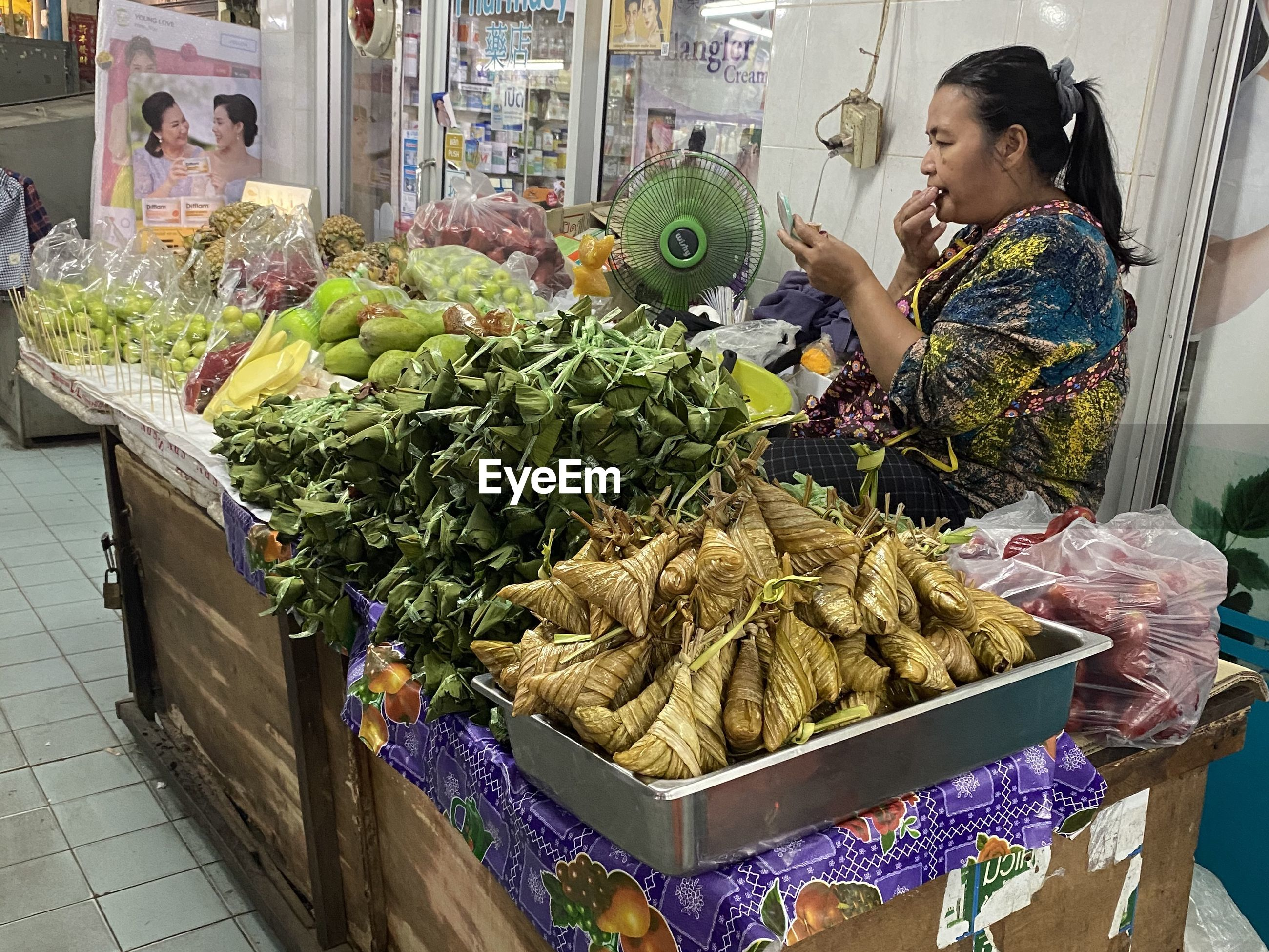 WOMAN IN MARKET STALL