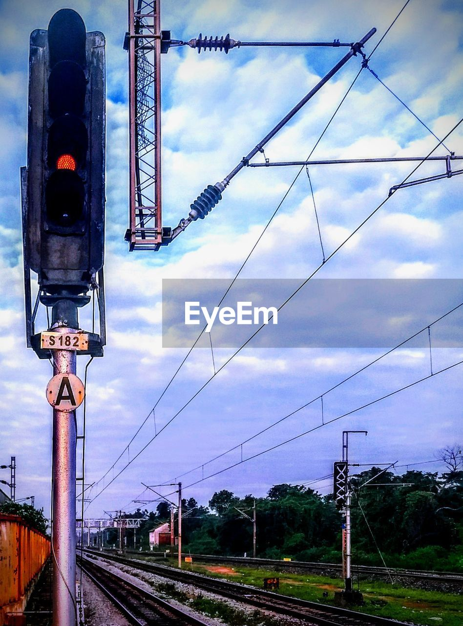 Low angle view of railroad signal against sky