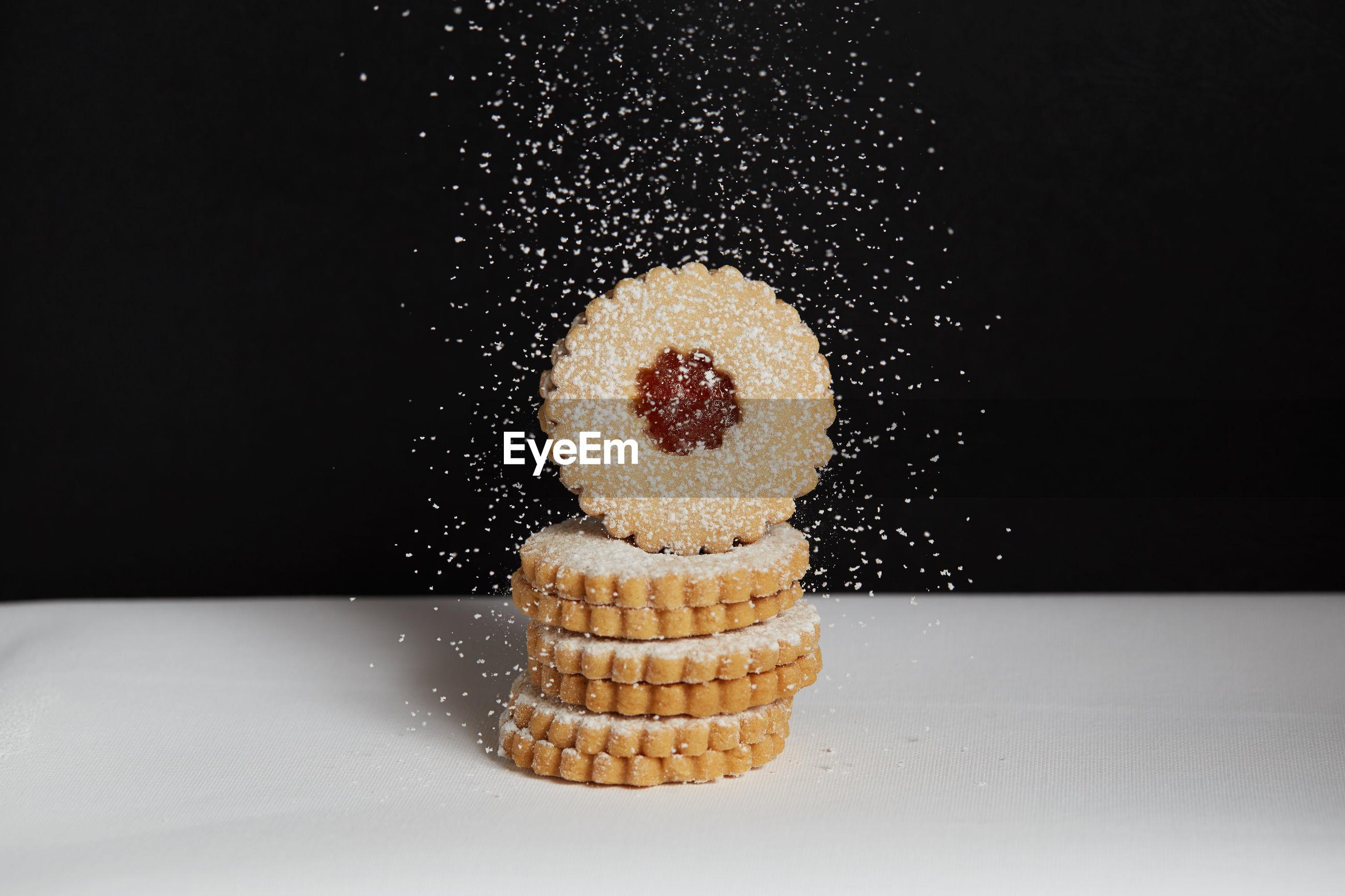 Sprinkling sugar on freshly baked homemade cookies