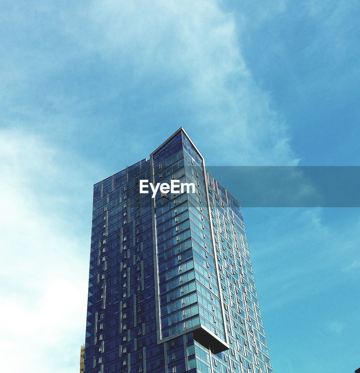 architecture, low angle view, building exterior, sky, skyscraper, built structure, day, modern, no people, outdoors, city