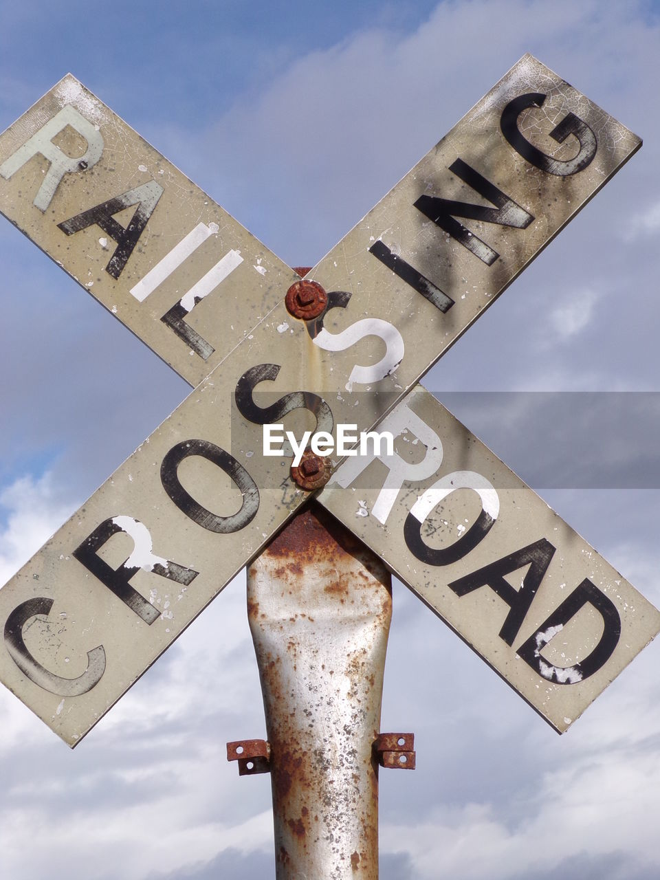 Low angle view of rail sign against sky