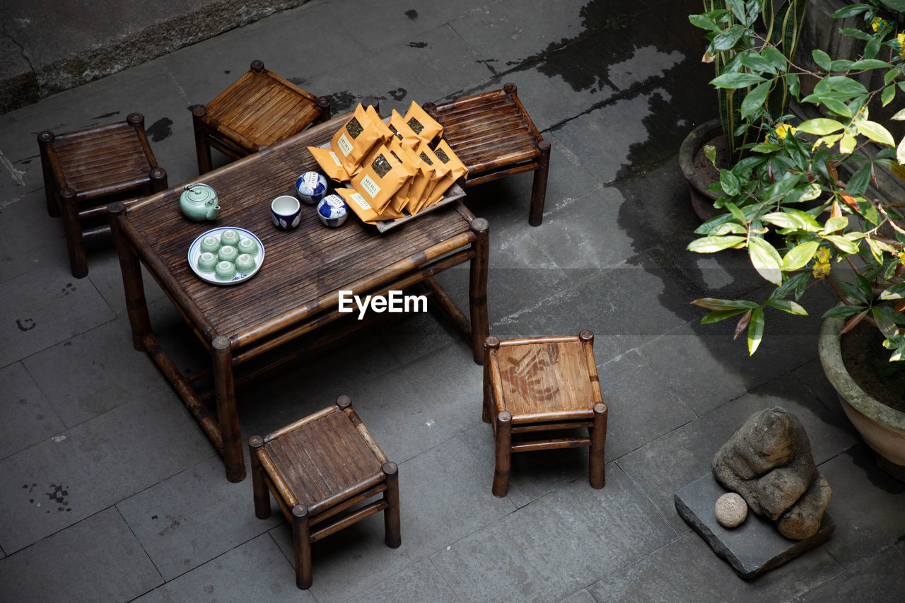 wood - material, table, seat, high angle view, no people, day, chair, food and drink, nature, furniture, relaxation, bench, still life, container, outdoors, food, plant, absence, cafe, flooring, tray