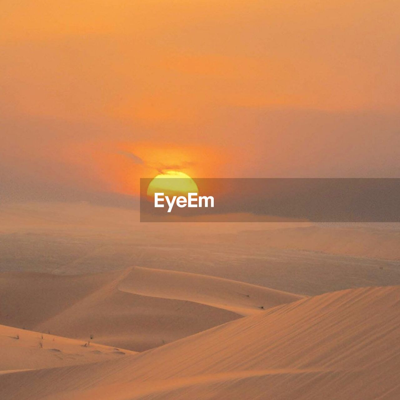 scenics, beauty in nature, nature, sunset, tranquil scene, tranquility, desert, orange color, landscape, arid climate, outdoors, no people, sun, sand dune, sky, day