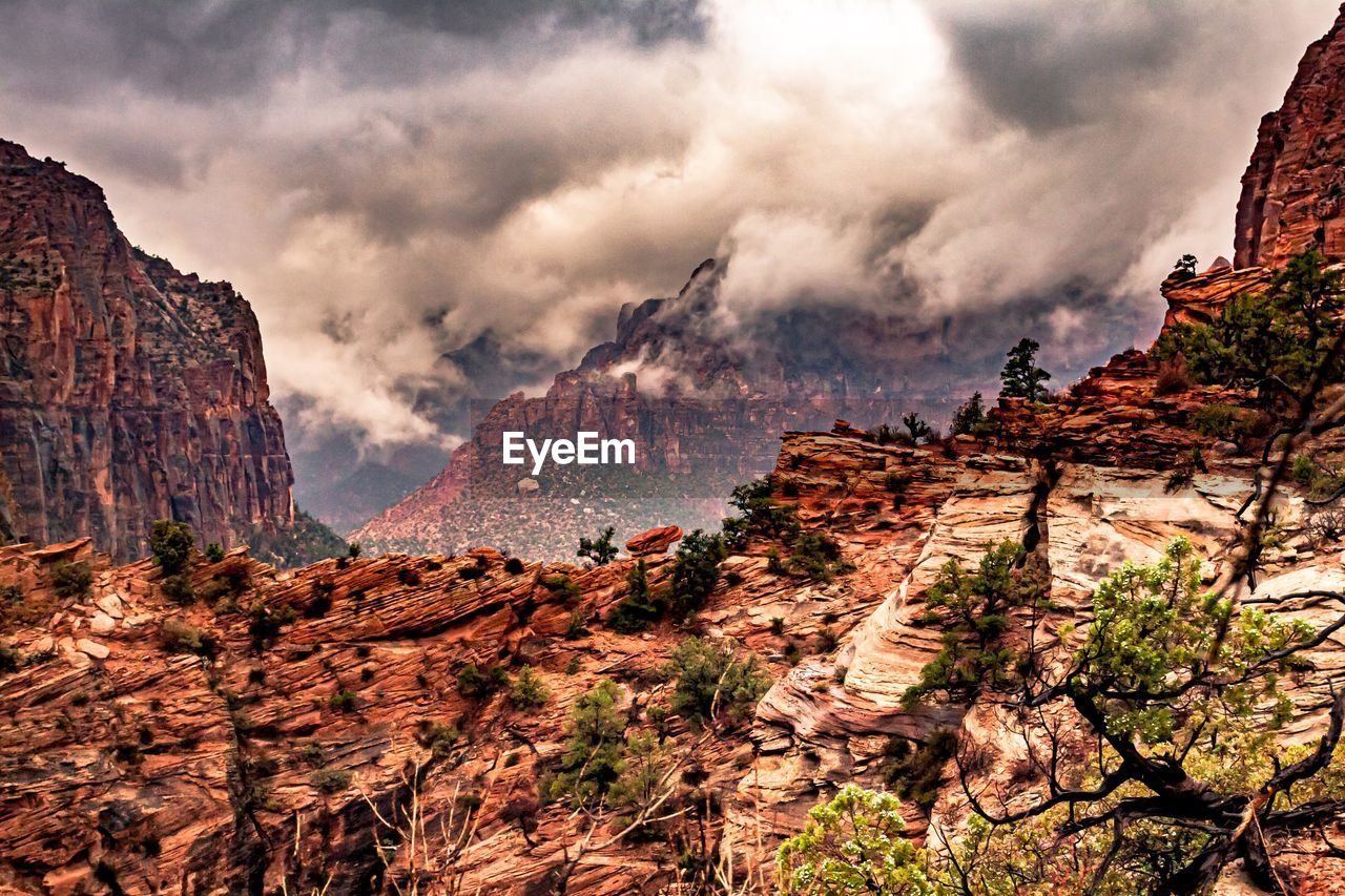 mountain, rock, beauty in nature, rock formation, scenics - nature, nature, cloud - sky, non-urban scene, sky, tranquil scene, geology, rock - object, land, solid, no people, physical geography, tranquility, environment, formation, rocky mountains, mountain range, outdoors, eroded, arid climate, climate, mountain peak