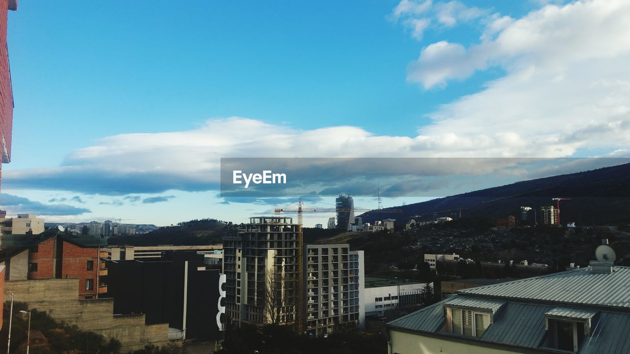 architecture, building exterior, built structure, cloud - sky, sky, city, no people, day, outdoors, cityscape