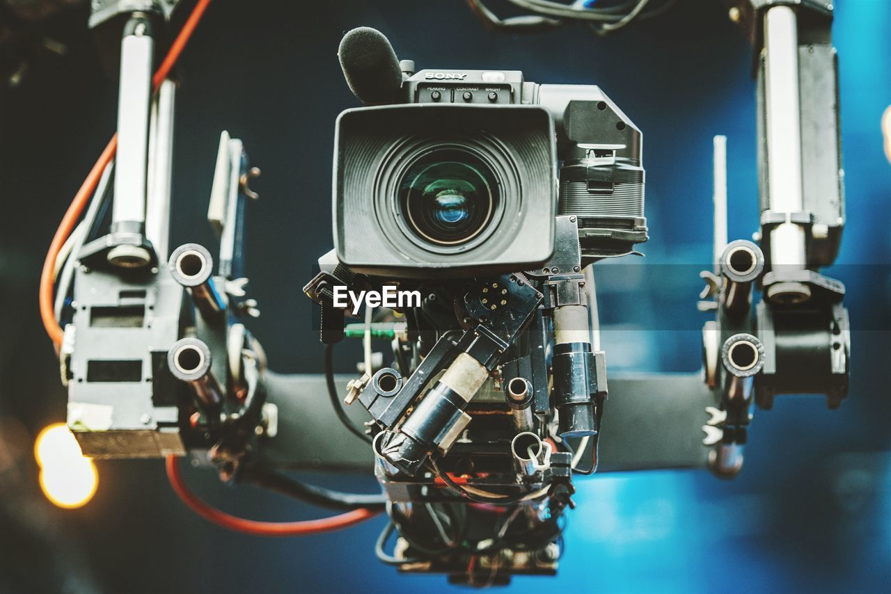 technology, focus on foreground, camera - photographic equipment, photography themes, close-up, indoors, film industry, no people, movie camera, recording studio, television camera, media equipment, day