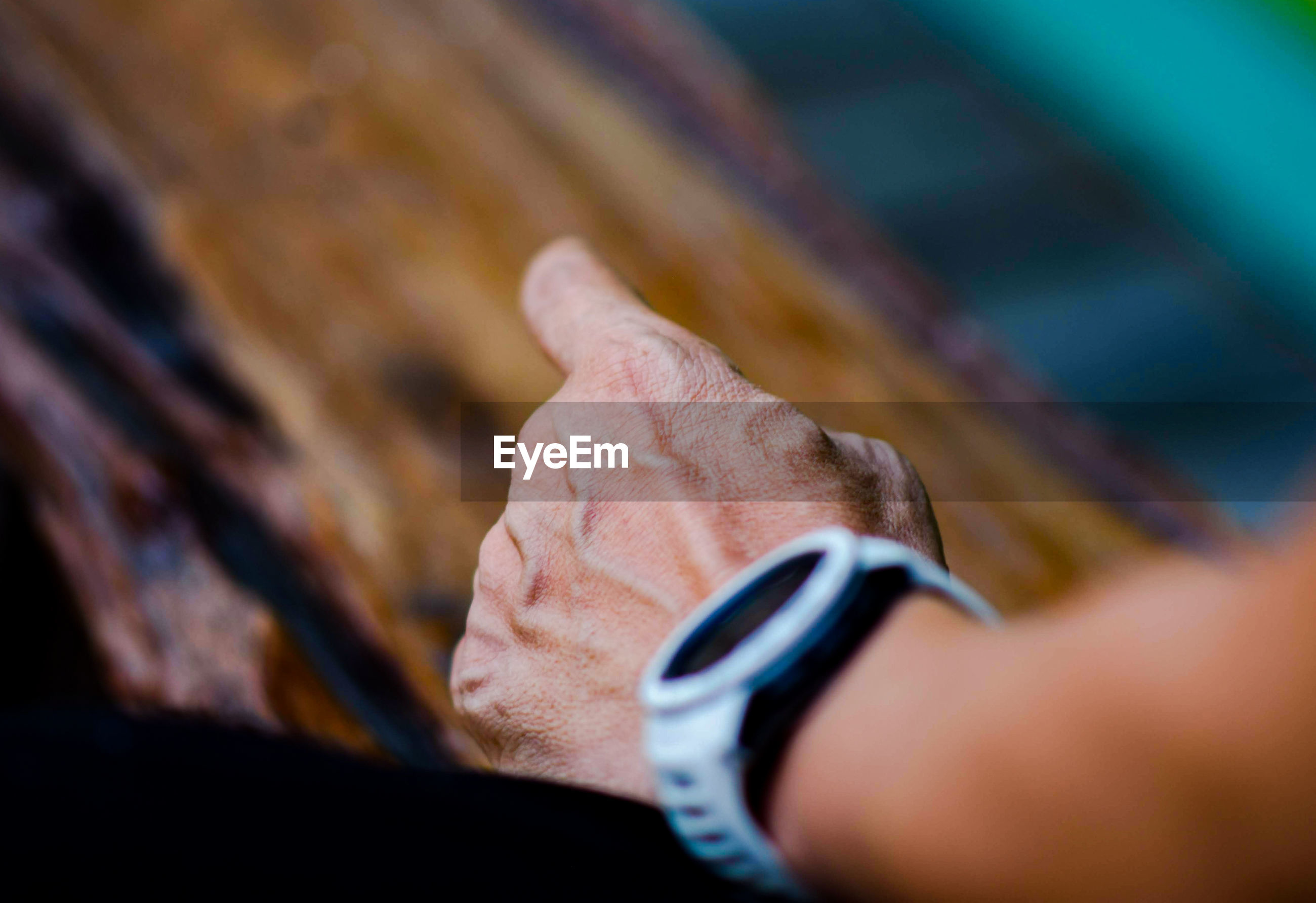 Close-up of person hand wearing wristwatch