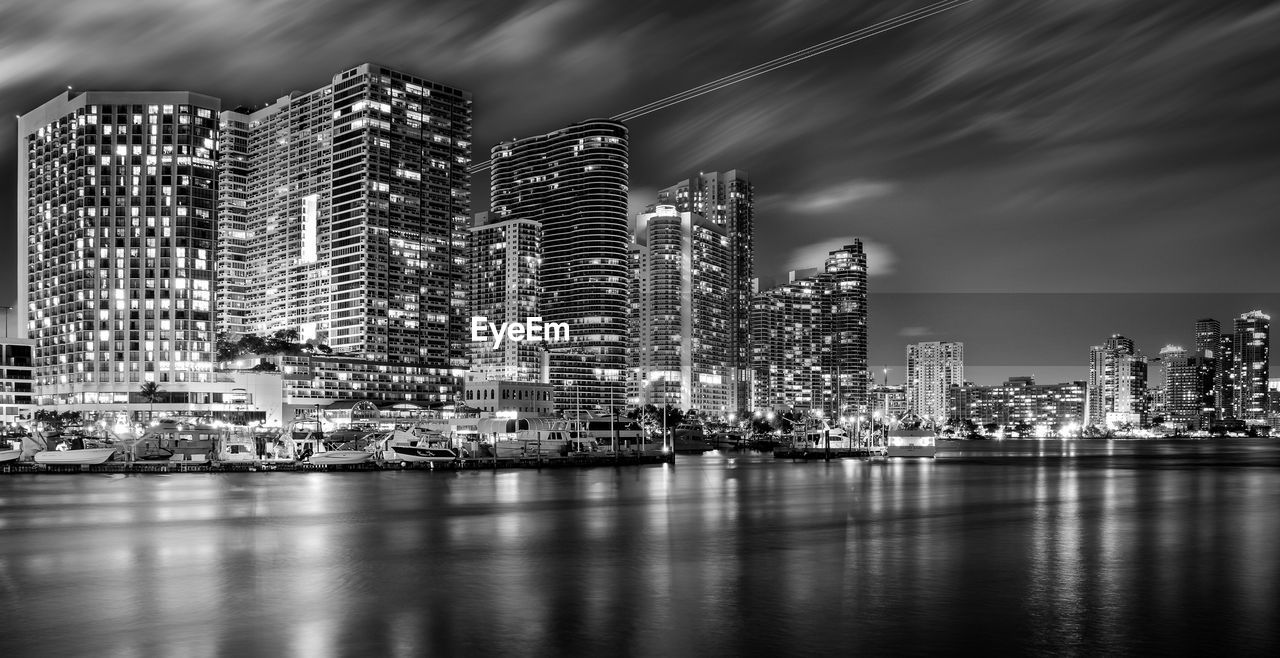 building exterior, built structure, architecture, city, building, waterfront, office building exterior, water, illuminated, skyscraper, sky, no people, cityscape, nature, night, office, urban skyline, modern, sea, outdoors, financial district, bay, marina