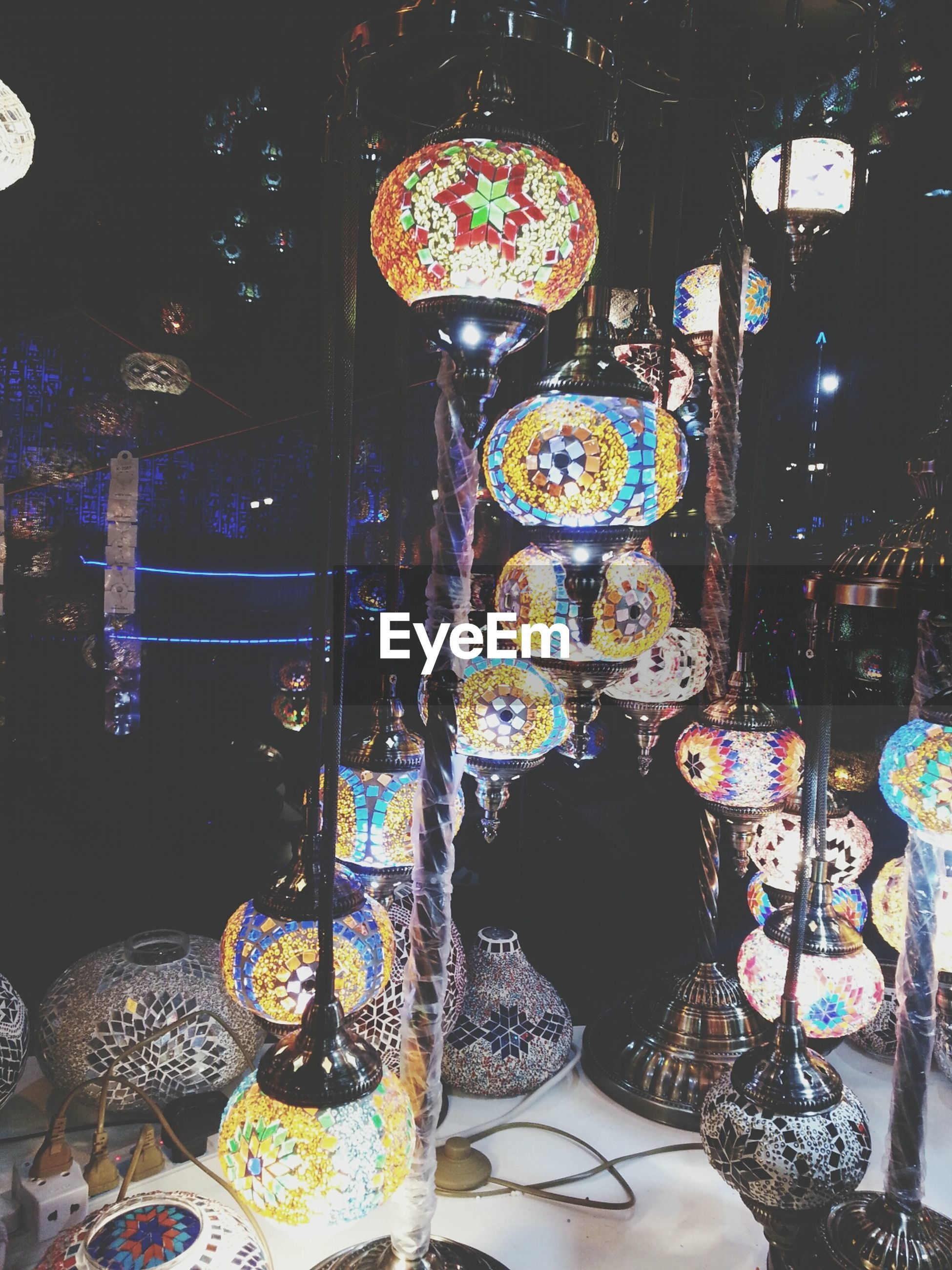 indoors, illuminated, night, decoration, hanging, lighting equipment, religion, celebration, arts culture and entertainment, built structure, tradition, art and craft, multi colored, retail, art, place of worship, cultures, creativity, person