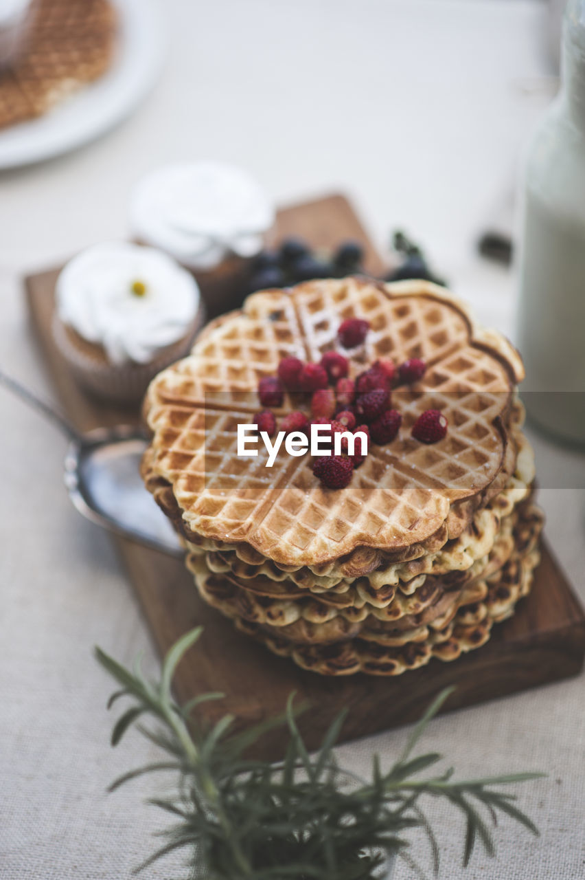 High Angle View Of Stacked Waffles On Tray