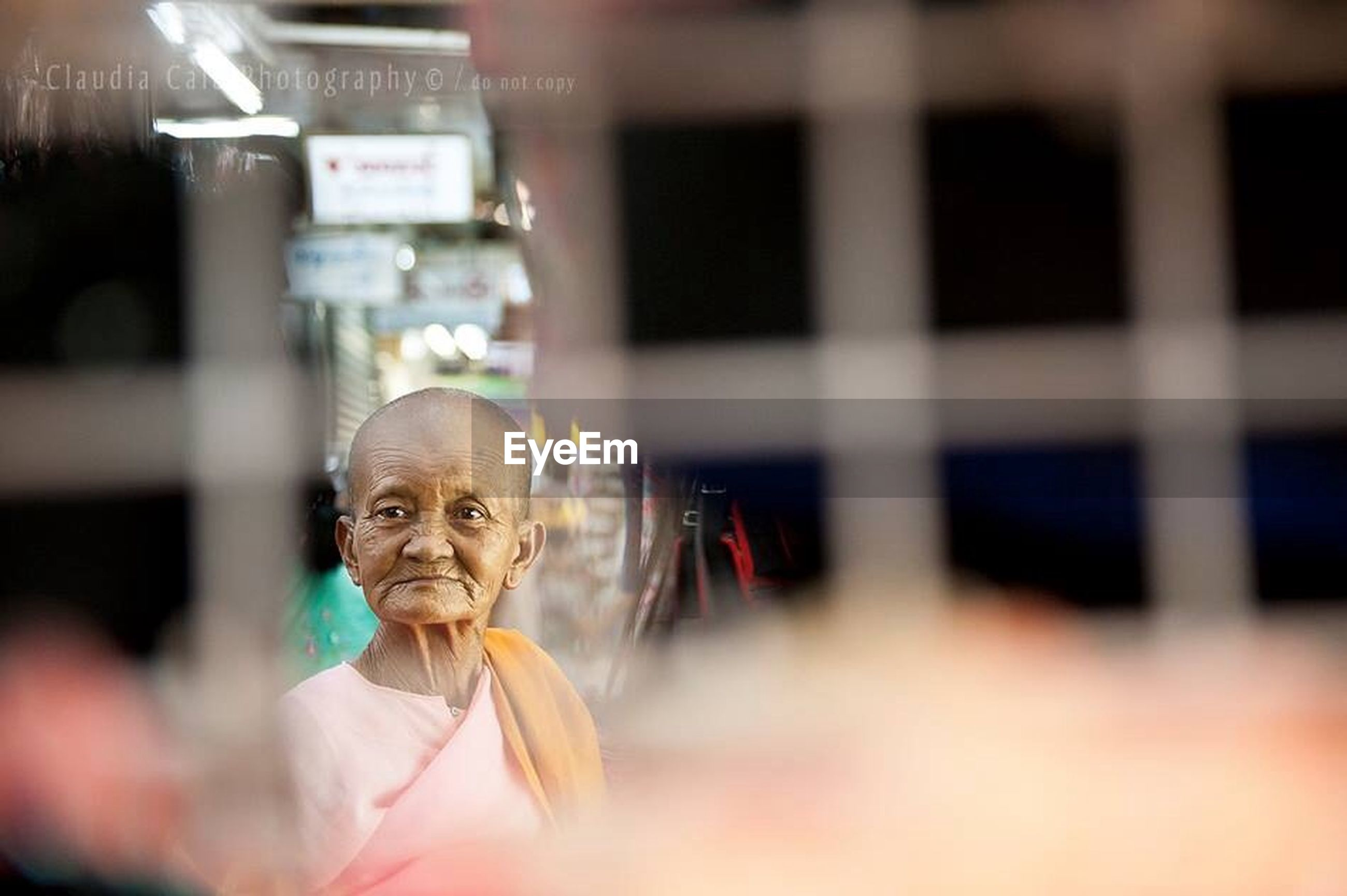 focus on foreground, selective focus, lifestyles, indoors, leisure activity, close-up, celebration, person, incidental people, illuminated, cultures, human representation, art and craft, arts culture and entertainment, tradition, creativity, day