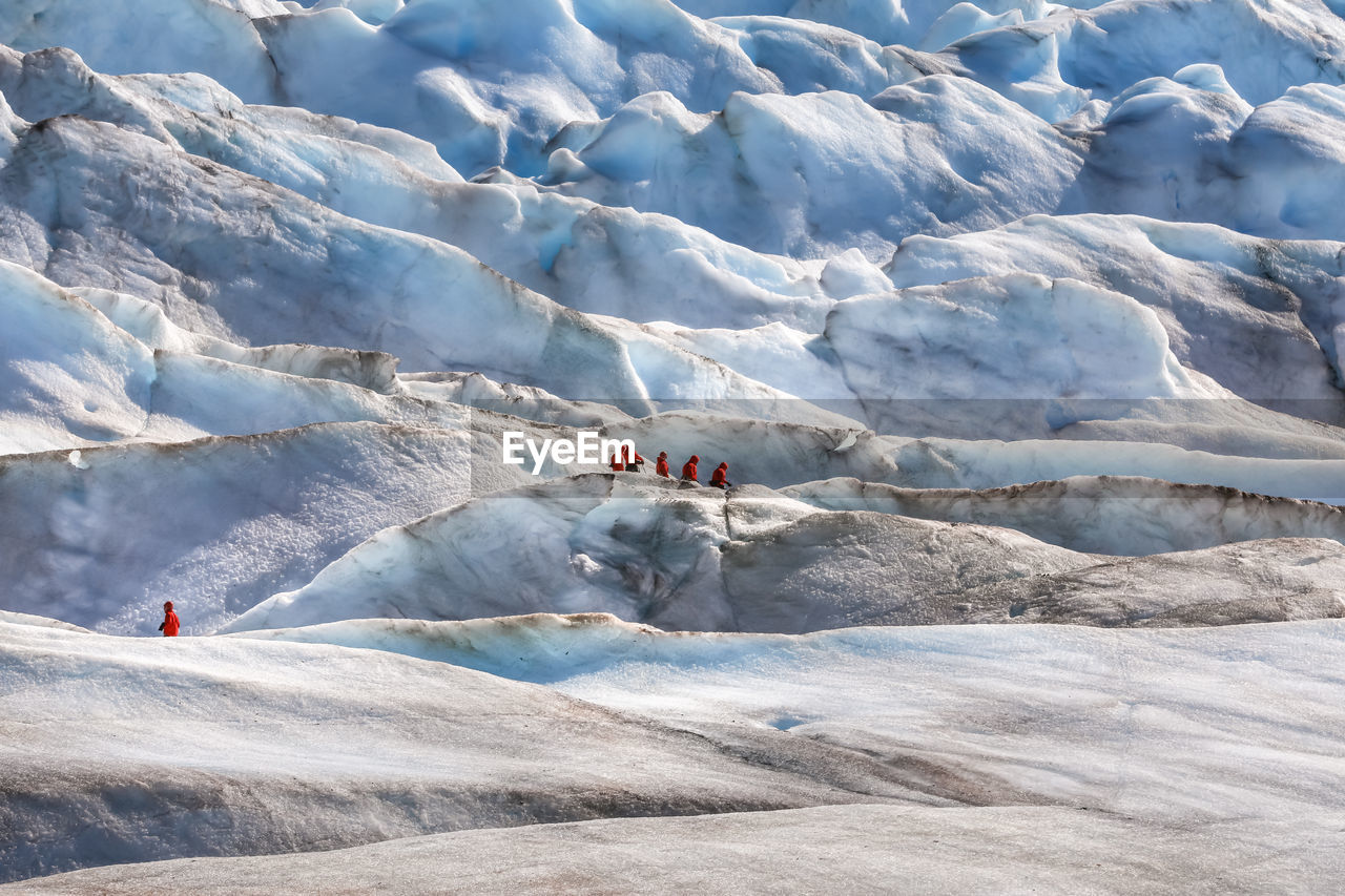 People On Glacier During Winter