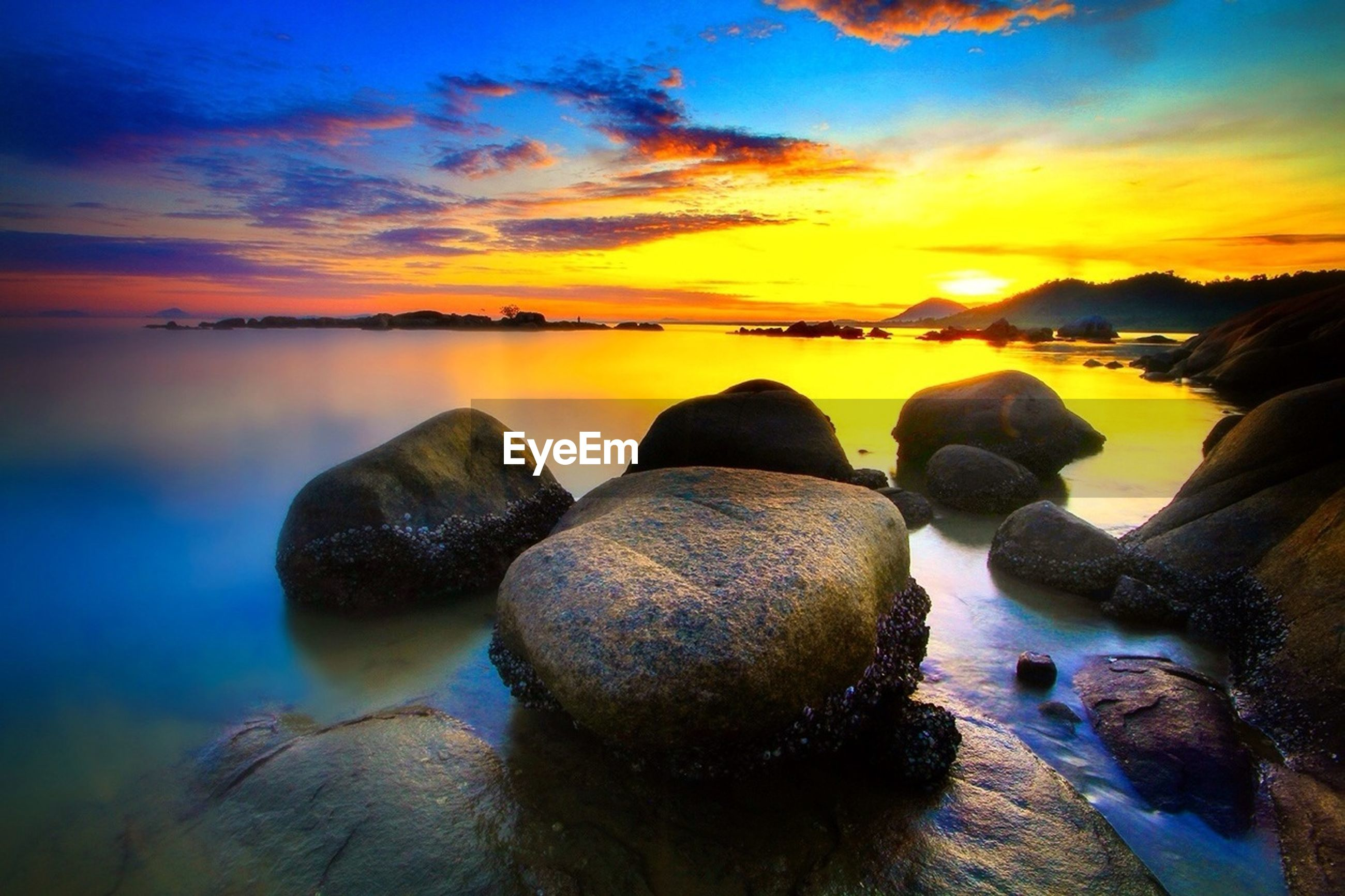 sunset, sea, water, sky, scenics, tranquil scene, beauty in nature, tranquility, beach, rock - object, cloud - sky, nature, horizon over water, idyllic, shore, reflection, orange color, cloud, dusk, rock