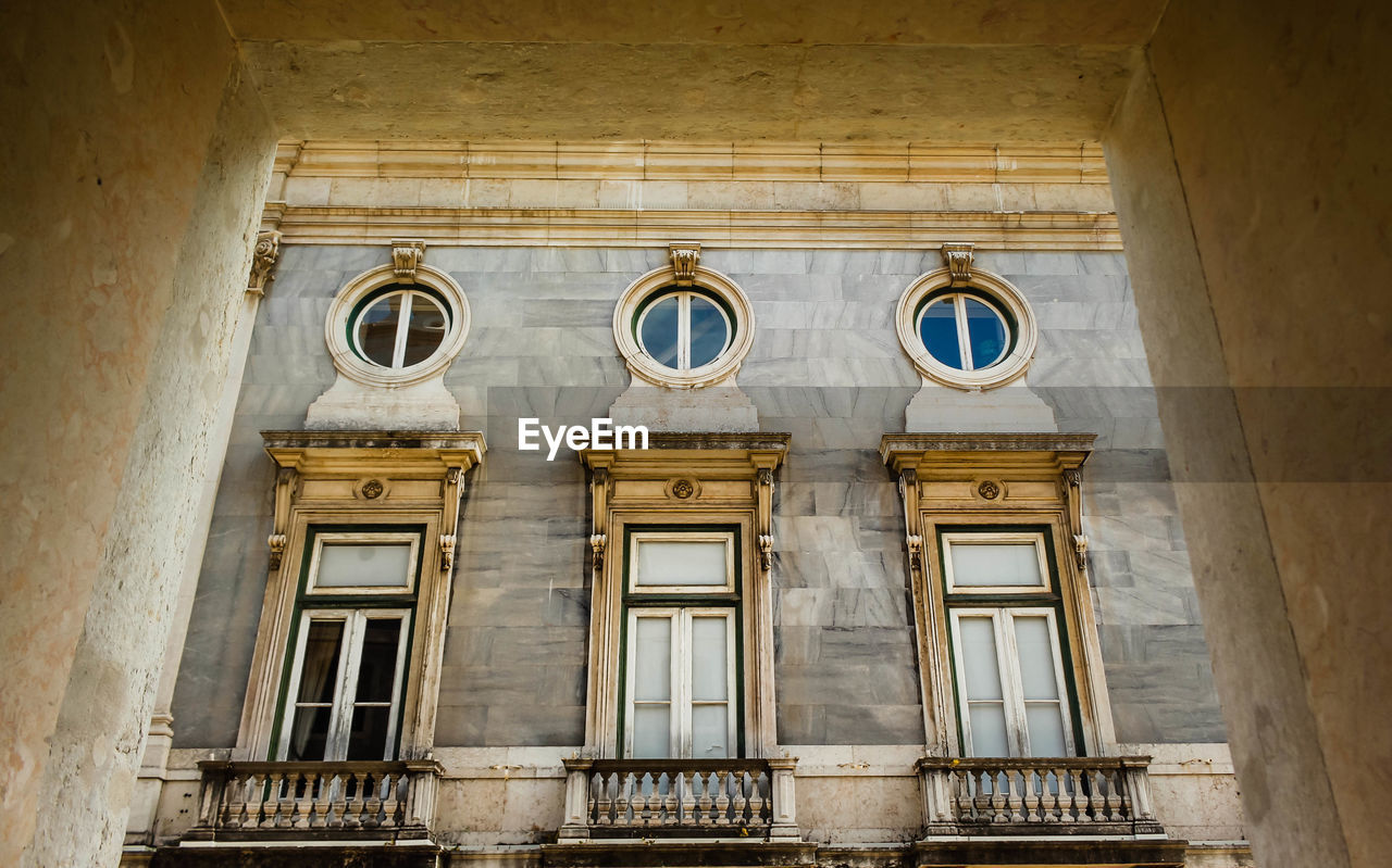 built structure, architecture, window, building exterior, low angle view, no people, building, old, day, the past, history, arch, outdoors, side by side, wall - building feature, glass - material, in a row, architectural column, abandoned, facade, ornate