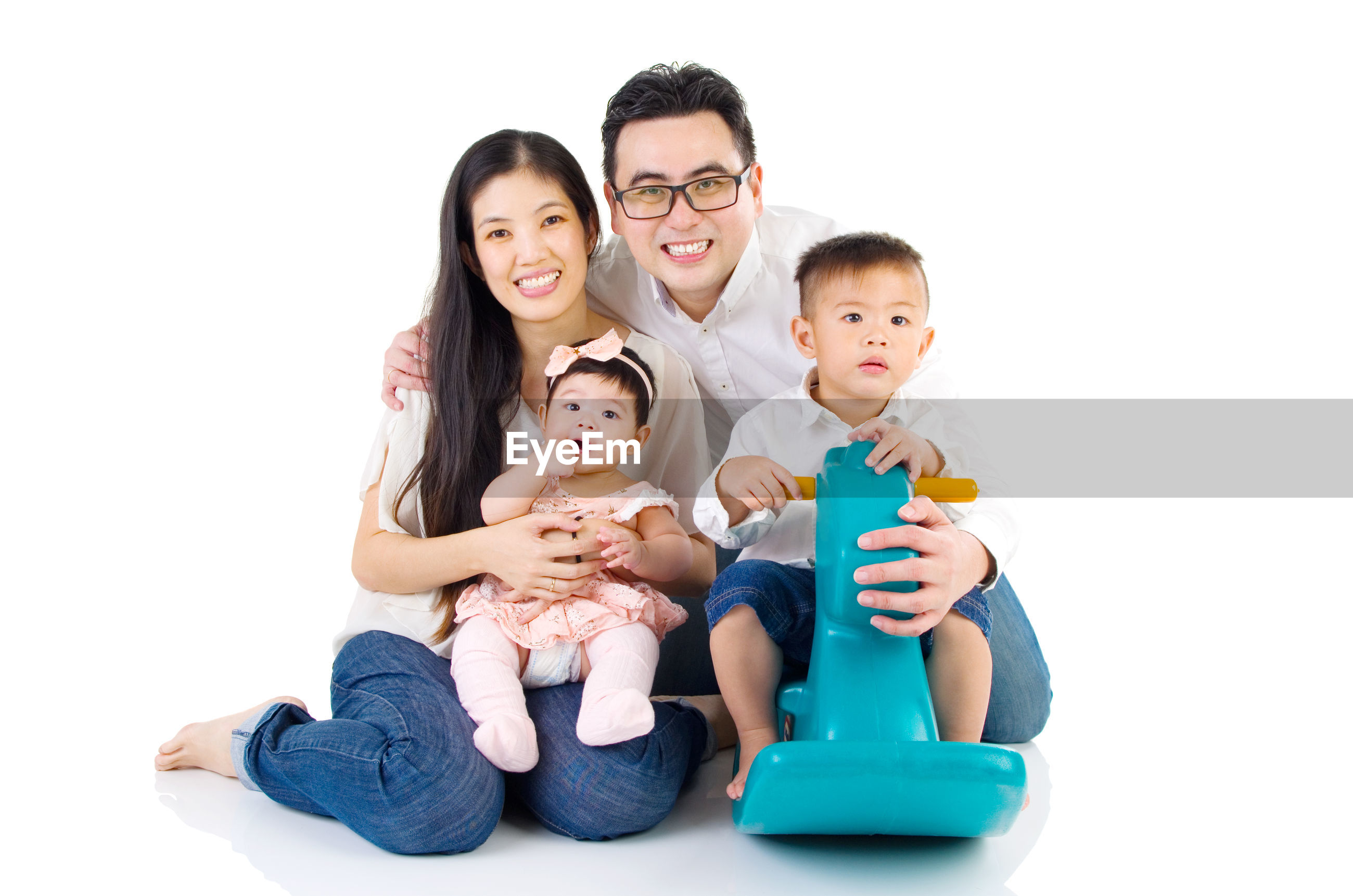 Portrait of parents with children on white background
