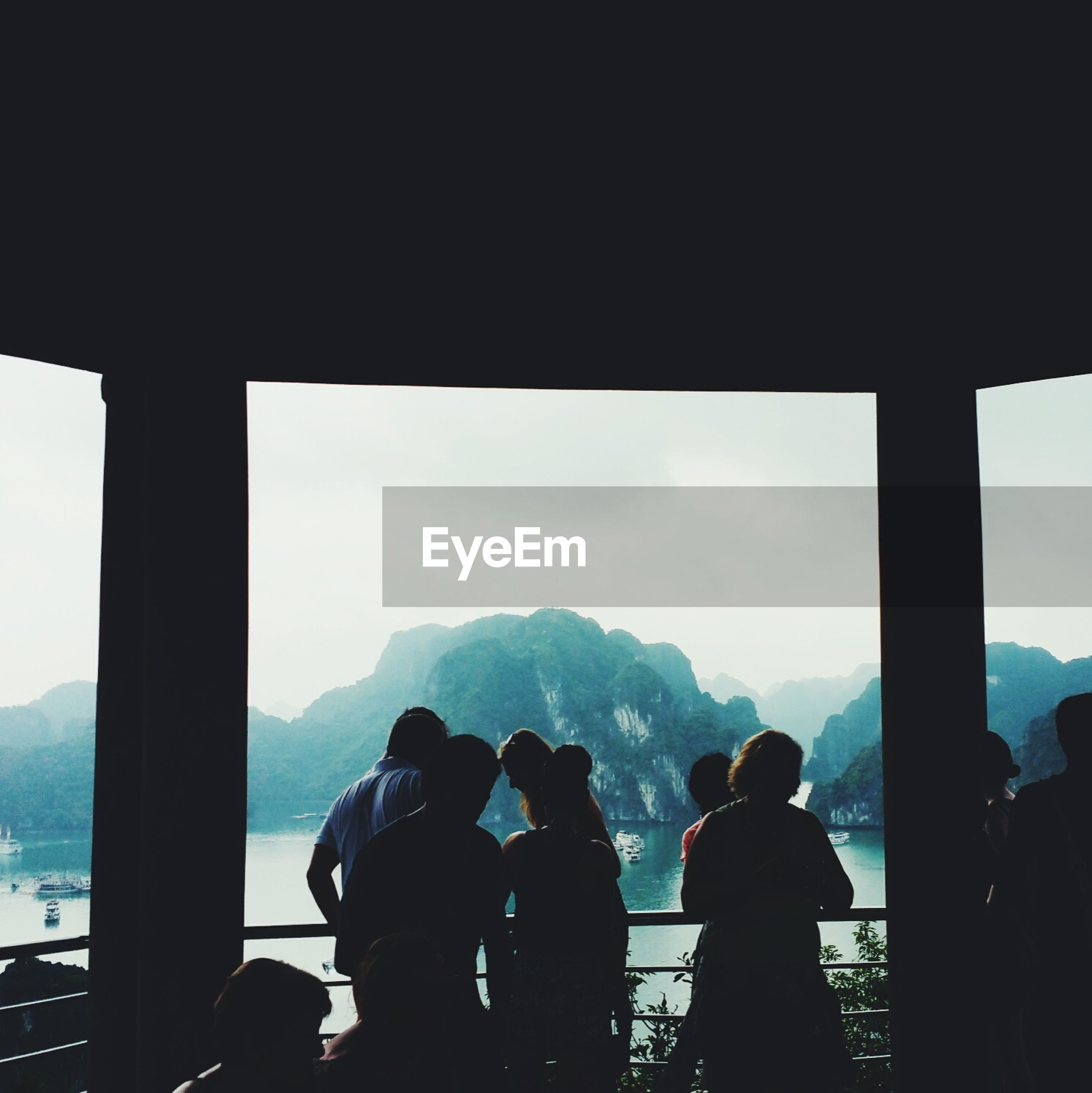 People at observation point against halong bay