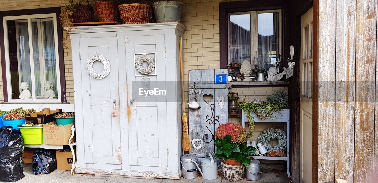 entrance, built structure, door, architecture, day, building exterior, no people, building, house, open, outdoors, wood - material, window, variation, choice, large group of objects, plant, closed, transparent, box