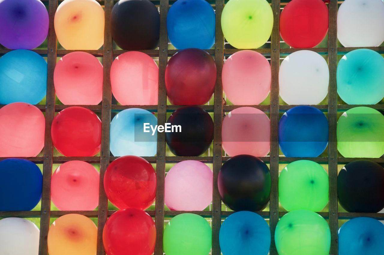 multi colored, full frame, backgrounds, large group of objects, choice, variation, indoors, no people, shape, side by side, arrangement, geometric shape, circle, abundance, still life, design, in a row, pattern, blue
