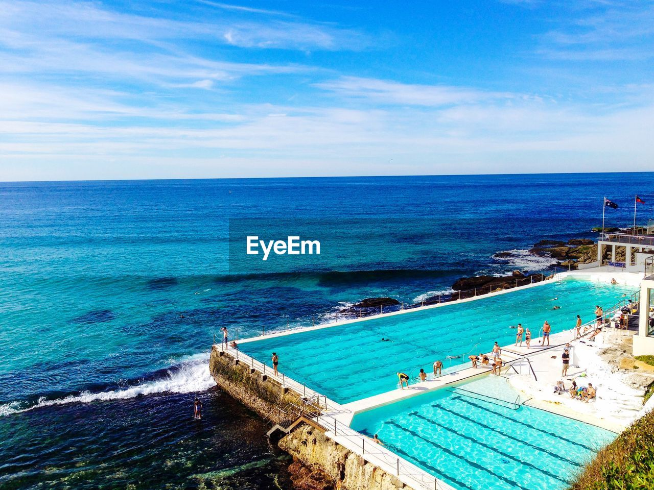 water, sea, horizon over water, horizon, sky, scenics - nature, beauty in nature, nature, blue, swimming pool, pool, day, high angle view, land, beach, group of people, cloud - sky, holiday, vacations, outdoors, turquoise colored