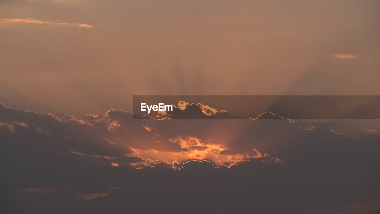 sky, cloud - sky, sunset, beauty in nature, scenics - nature, tranquil scene, tranquility, nature, no people, orange color, idyllic, low angle view, silhouette, outdoors, mountain, dramatic sky, sunlight, non-urban scene, environment