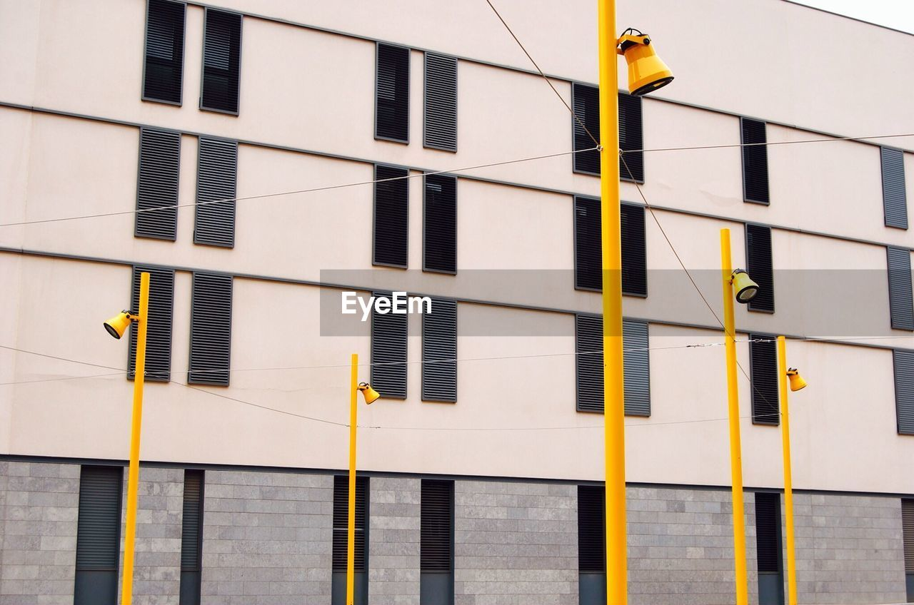 Modern Building Exterior And Yellow Street Lights