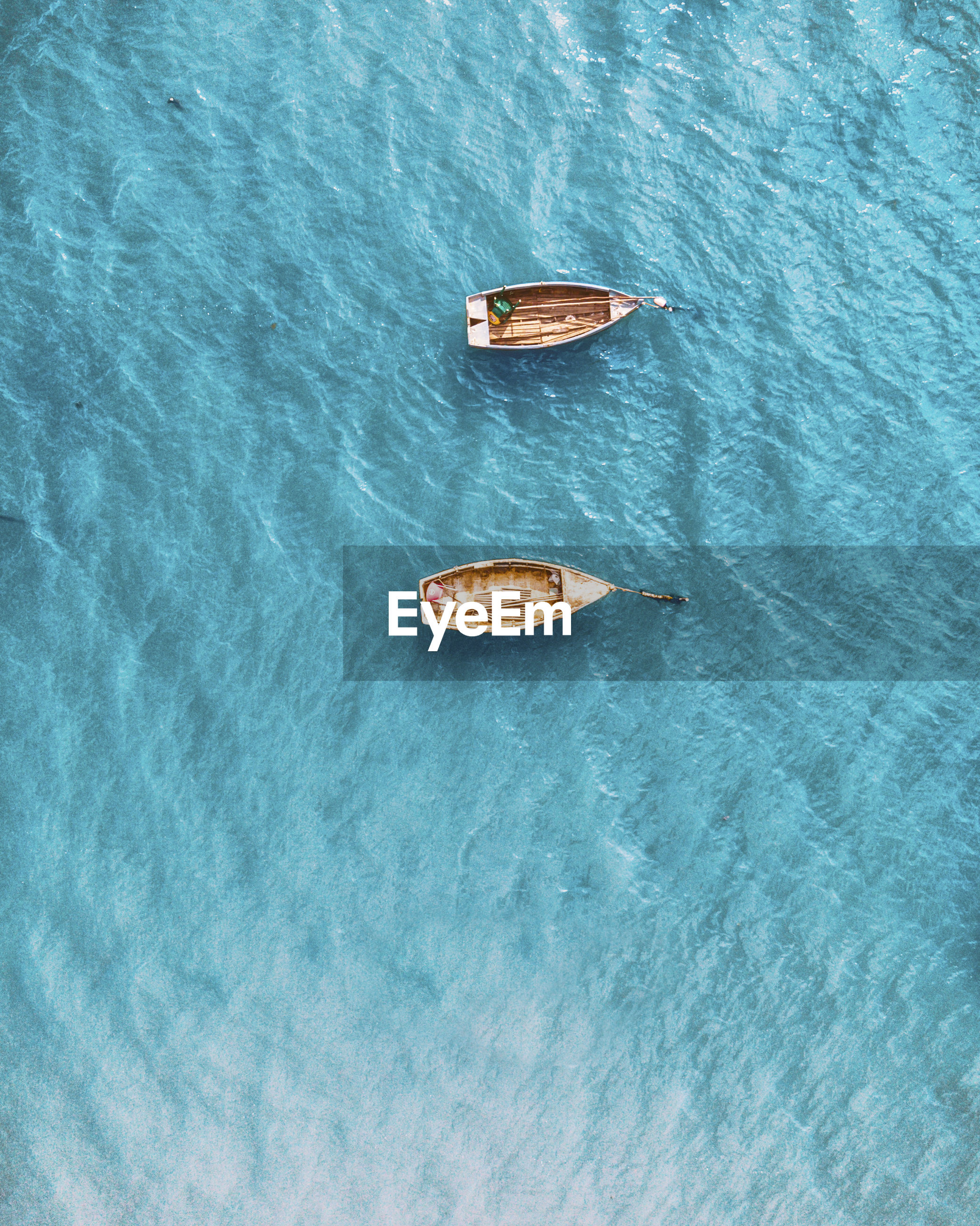 High angle view of empty boat floating on sea