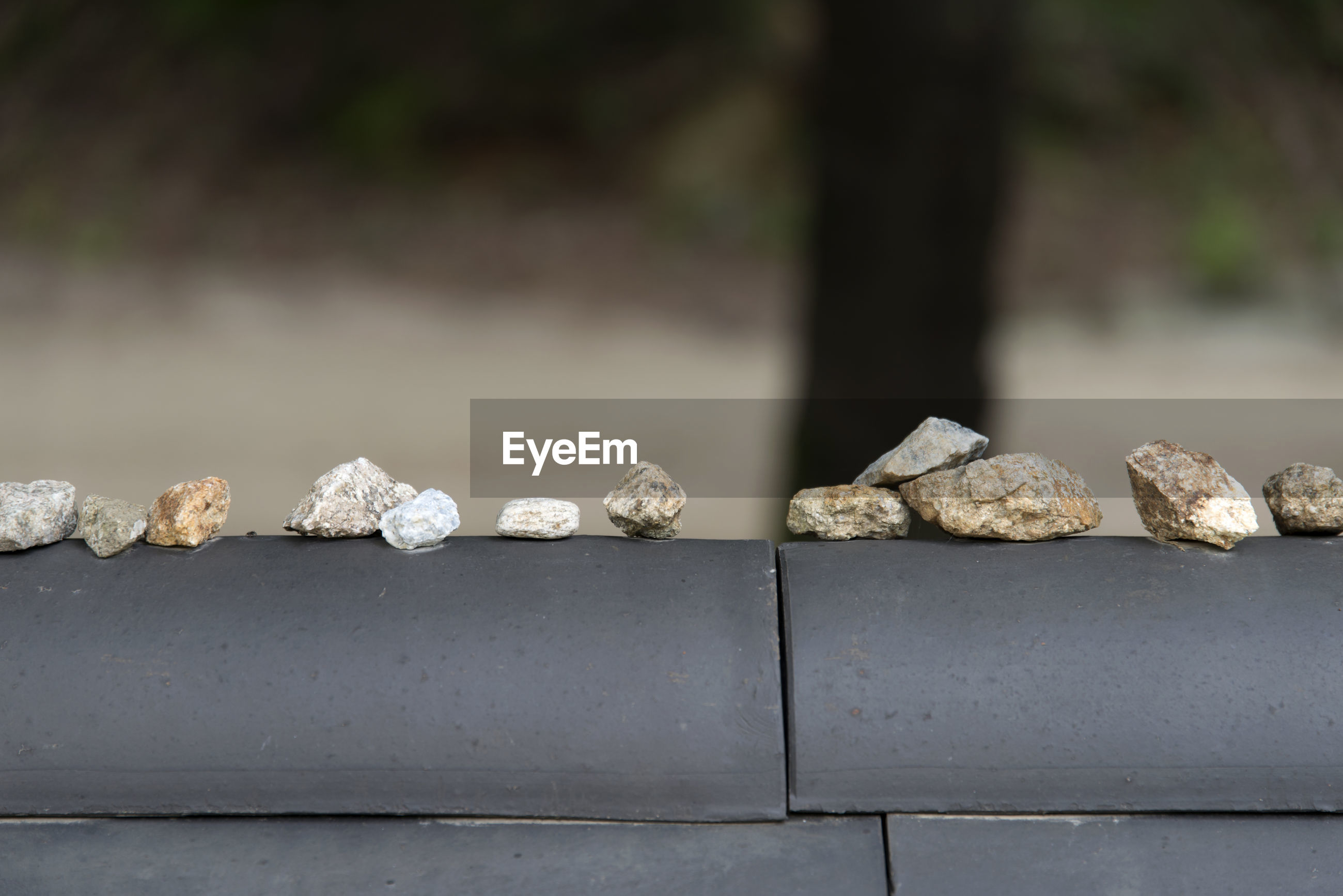 Close-up of stones on retaining wall