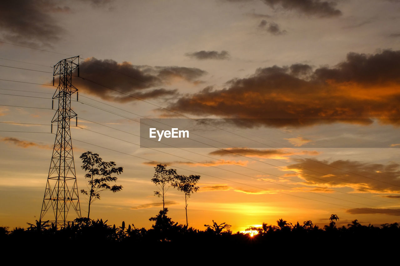 sunset, sky, silhouette, cloud - sky, technology, beauty in nature, electricity, plant, tree, power line, low angle view, cable, scenics - nature, orange color, electricity pylon, fuel and power generation, power supply, connection, nature, tranquil scene, no people, outdoors, telephone line, romantic sky