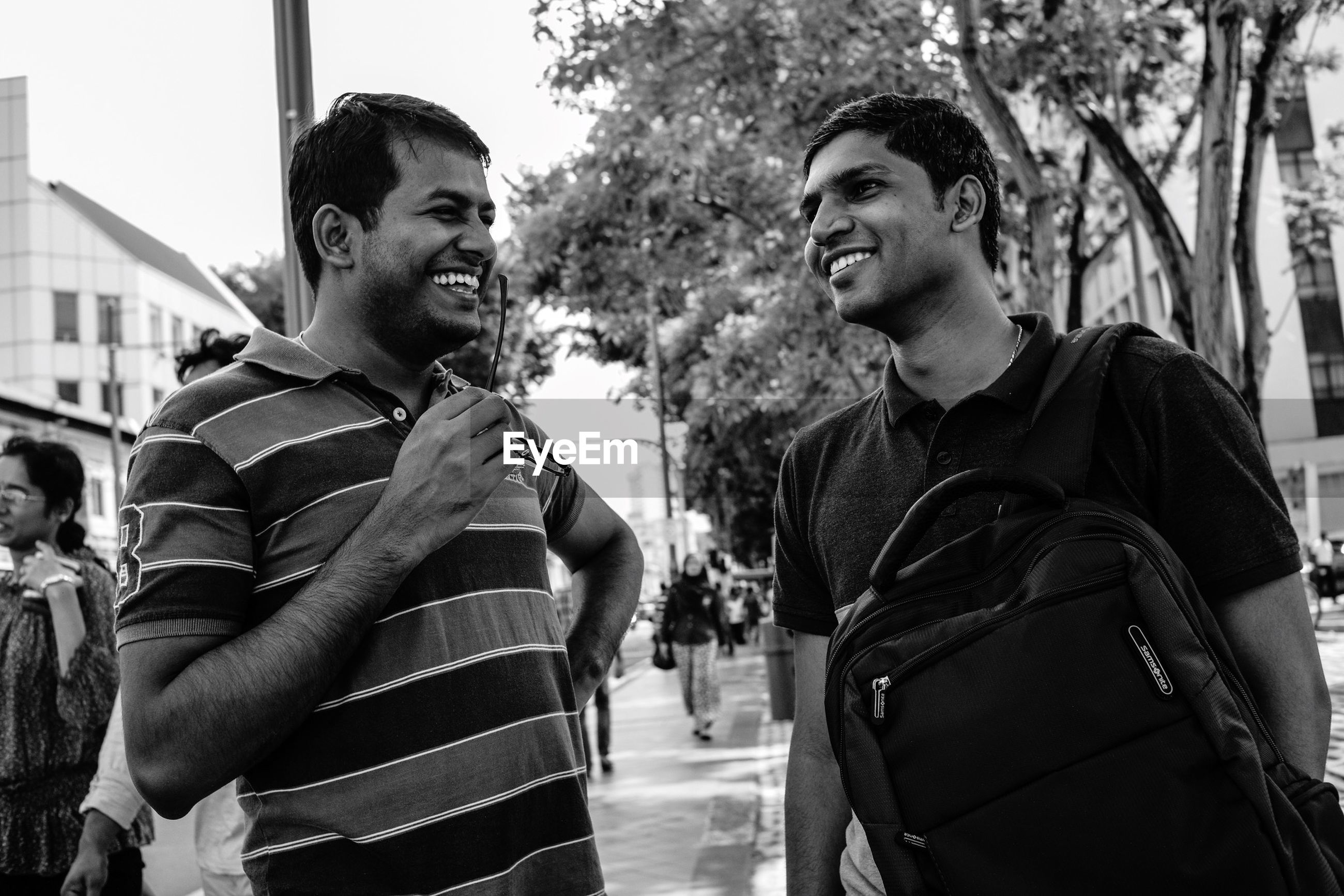 person, young adult, lifestyles, looking at camera, portrait, casual clothing, leisure activity, front view, smiling, young men, happiness, togetherness, bonding, toothy smile, friendship, standing
