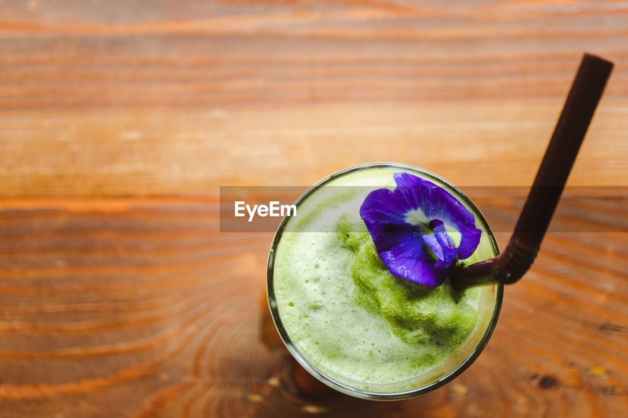 food and drink, table, freshness, food, drink, wood - material, refreshment, still life, healthy eating, close-up, indoors, fruit, no people, glass, wellbeing, focus on foreground, household equipment, drinking glass, high angle view, drinking straw, purple